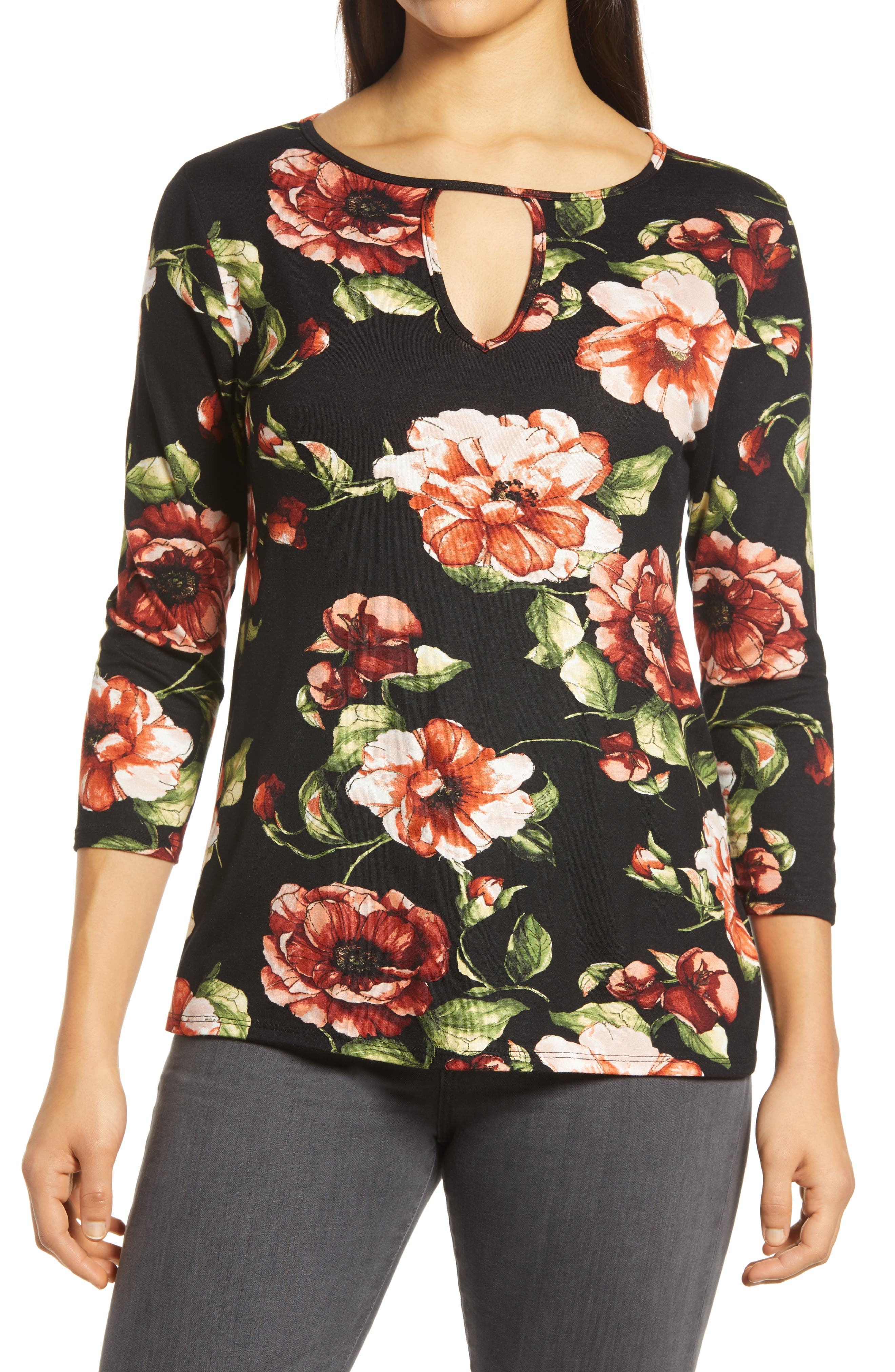A painterly floral print combines with a bold yet modest keyhole neckline and three-quarter sleeves to take this effortlessly stylish top to the next level. Style Name: Loveappella Floral Keyhole Top. Style Number: 6134062. Available in stores.