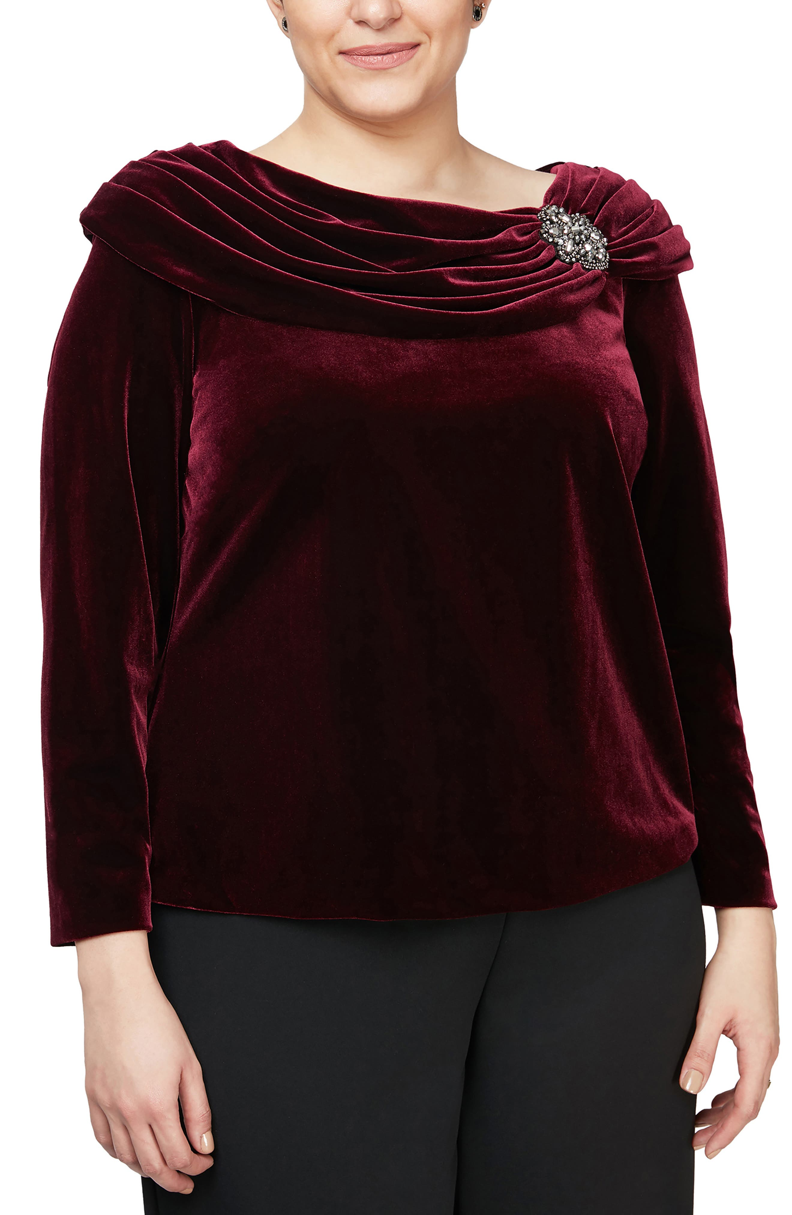 A rich velvet top clasped with a twinkling brooch and colored in a cabernet hue adds unmistakable glamour to your look whether you\\\'re going for fun or fancy. Style Name: Alex Evenings Brooch Detail Long Sleeve Velvet Top (Plus Size). Style Number: 6117951. Available in stores.
