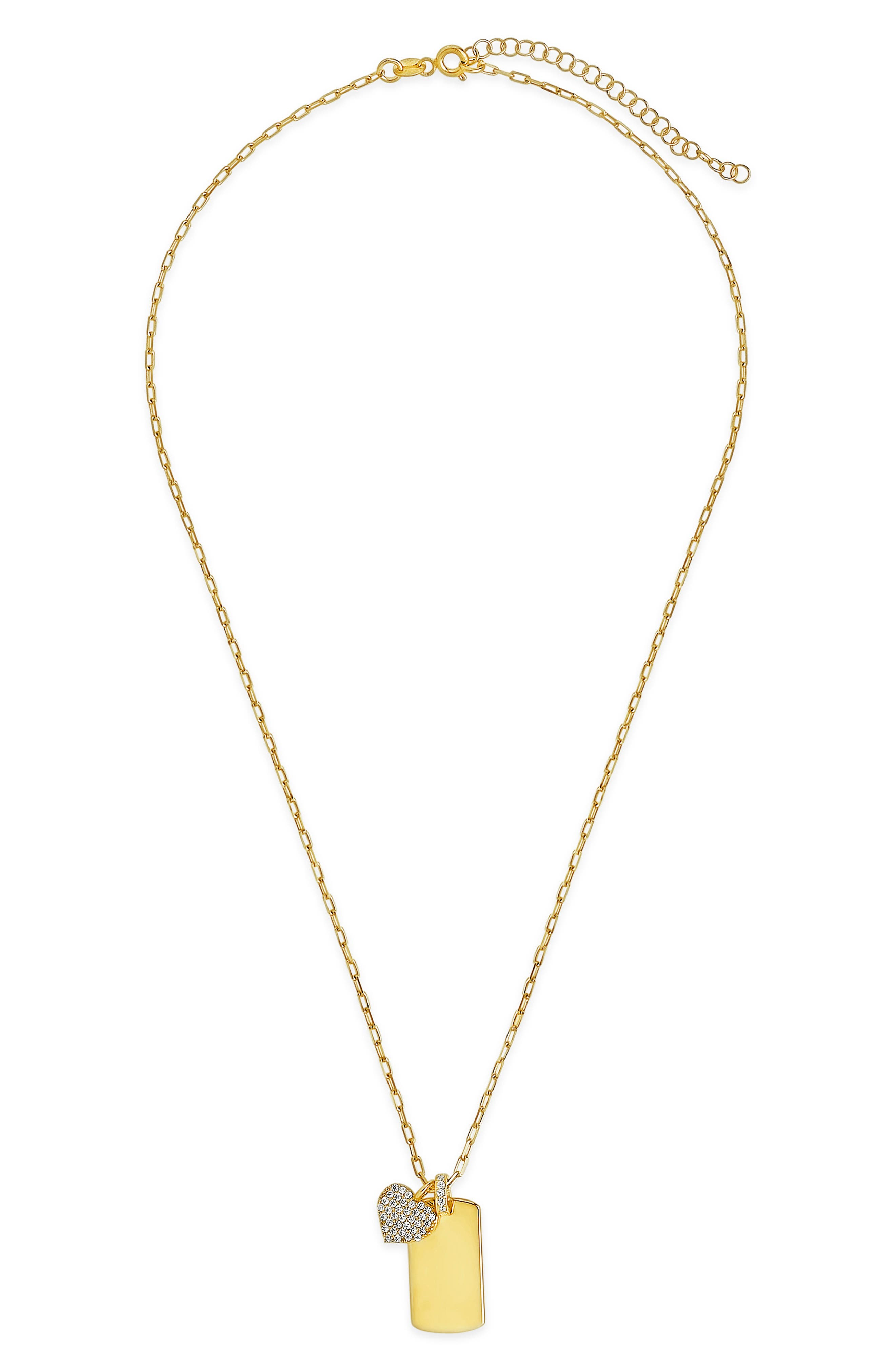 Sparkling crystals dazzle the heart pendant suspended with a sleek, glimmering tag on a chain-link necklace. Style Name: Sterling Forever Tag & Heart Pendant Necklace. Style Number: 6173949. Available in stores.