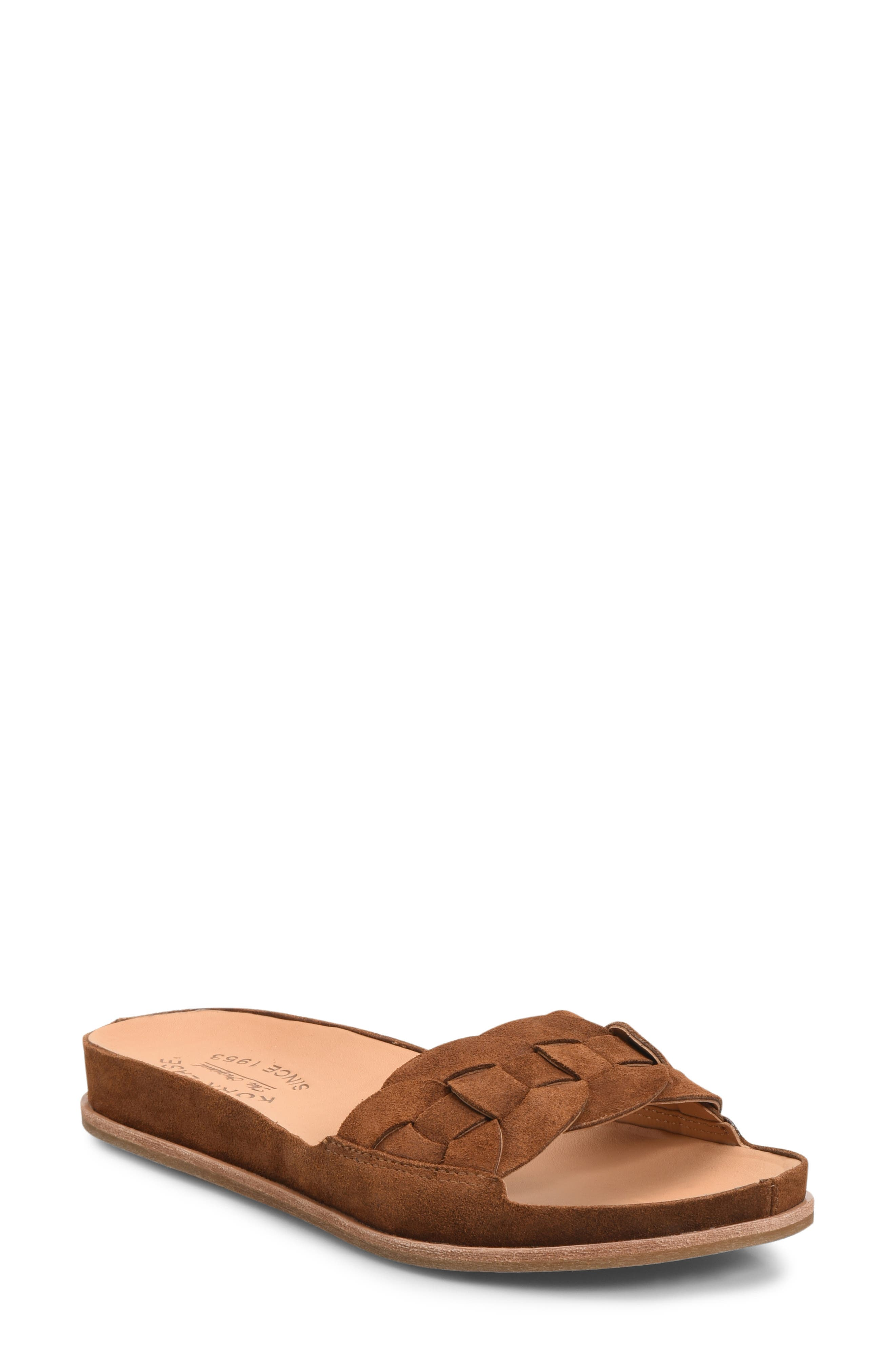 Boho-chic for the minimalist, this comfortable and arch-supportive flat sandal features a braided strap and wrapped midsole. Style Name: Kork-Ease Dolphin Slide Sandal (Women). Style Number: 5789539. Available in stores.