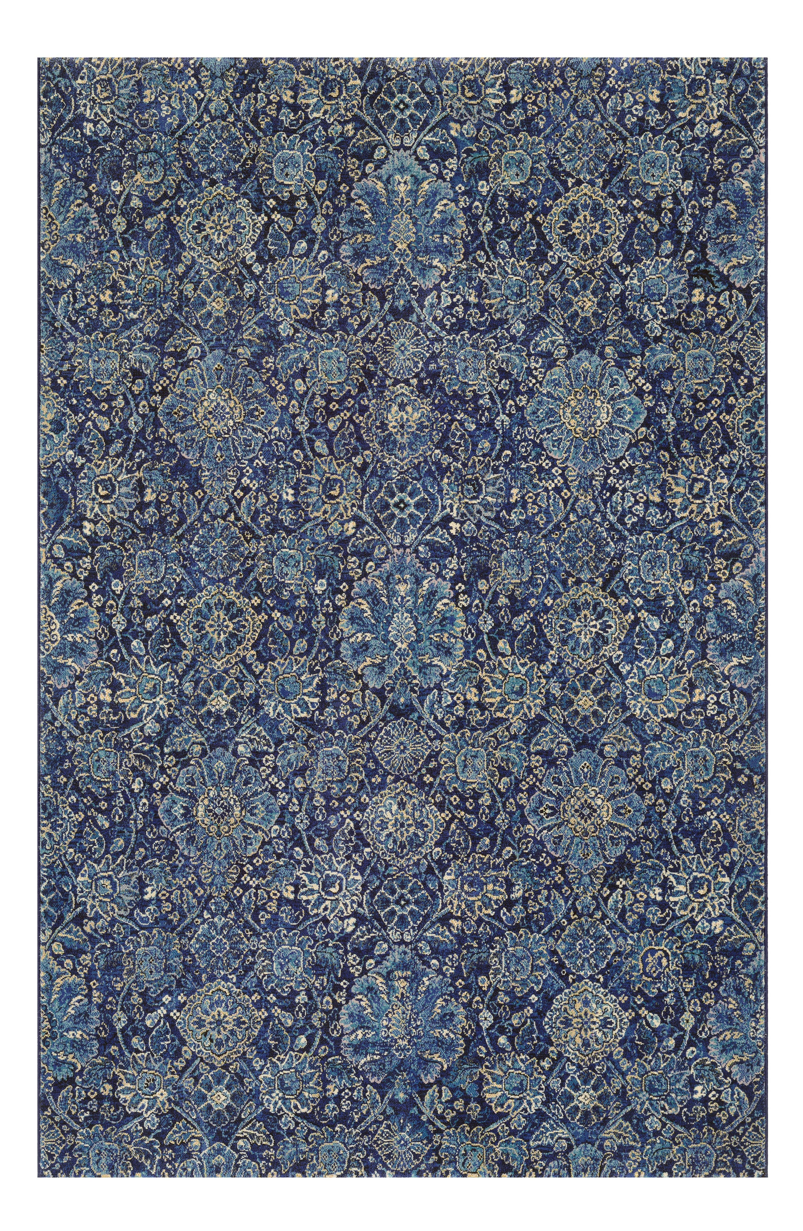 A garden of intricate blooms washes across a versatile rug power-loomed in fade-resistant polypropylene, making it great for high-traffic areas both inside and outside. Style Name: Couristan Winslet Indoor/outdoor Rug. Style Number: 5366836. Available in stores.