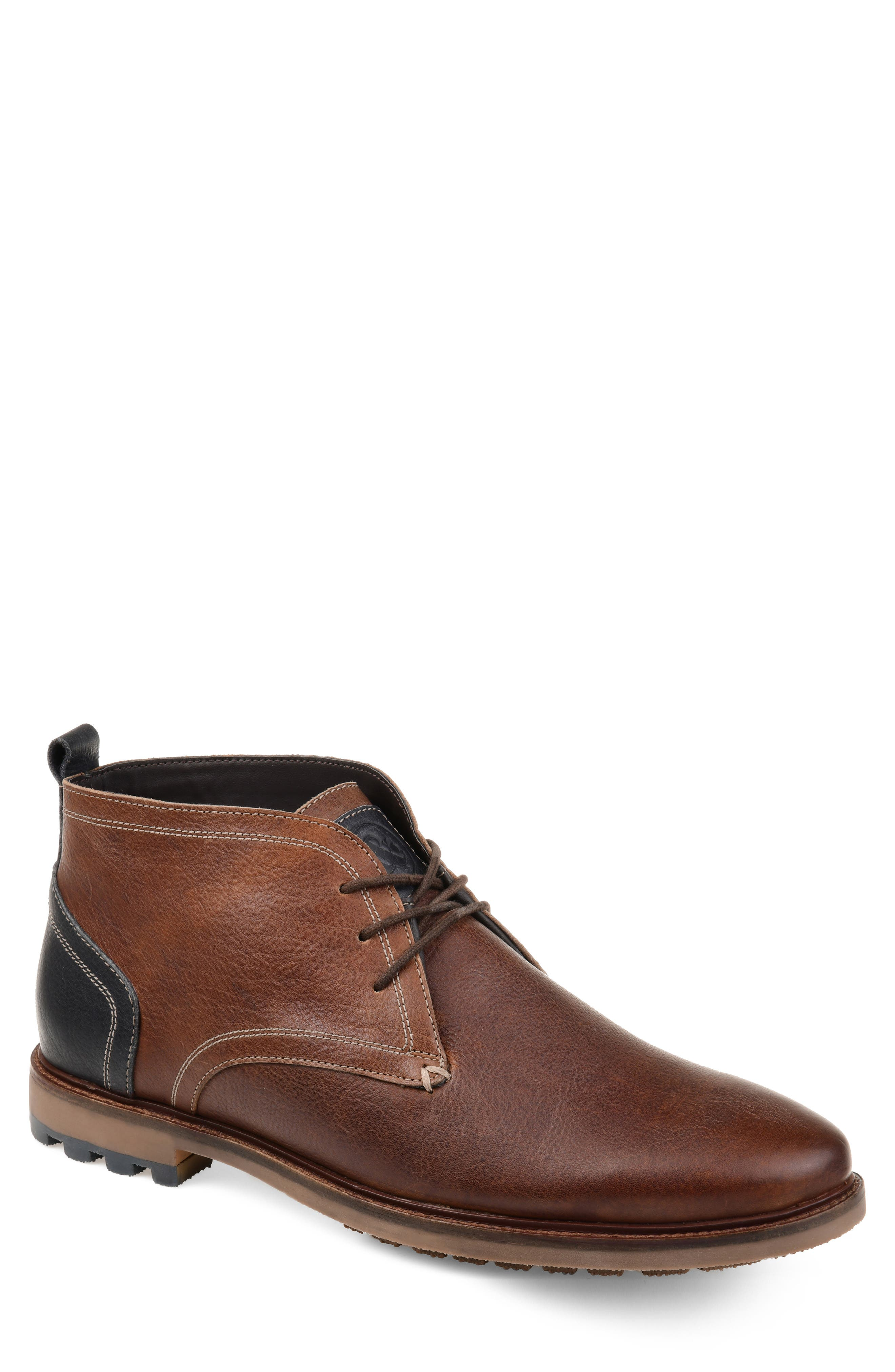 A lugged rubber tread securely grounds a chukka boot crafted to keep water at bay from richly pebbled leather with bold color blocking at the heel. Style Name: Thomas & Vine Logan Waterproof Chukka Boot (Men). Style Number: 5715630. Available in stores.