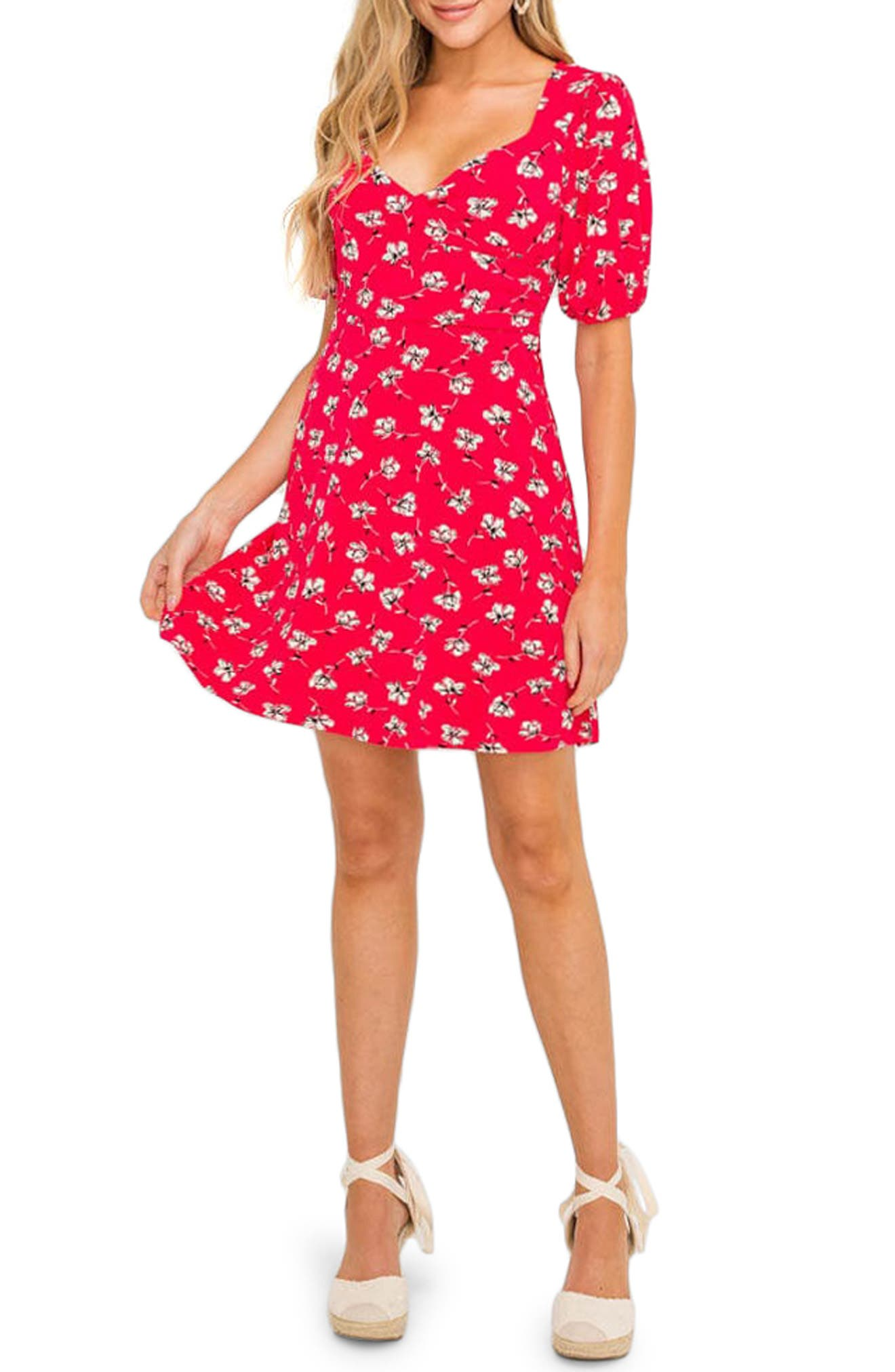 A sweet print enlivens this pretty, puff-sleeve frock styled with a cross-front bodice and a swingy skirt. Style Name: All In Favor Surplice Minidress. Style Number: 6032181 1. Available in stores.