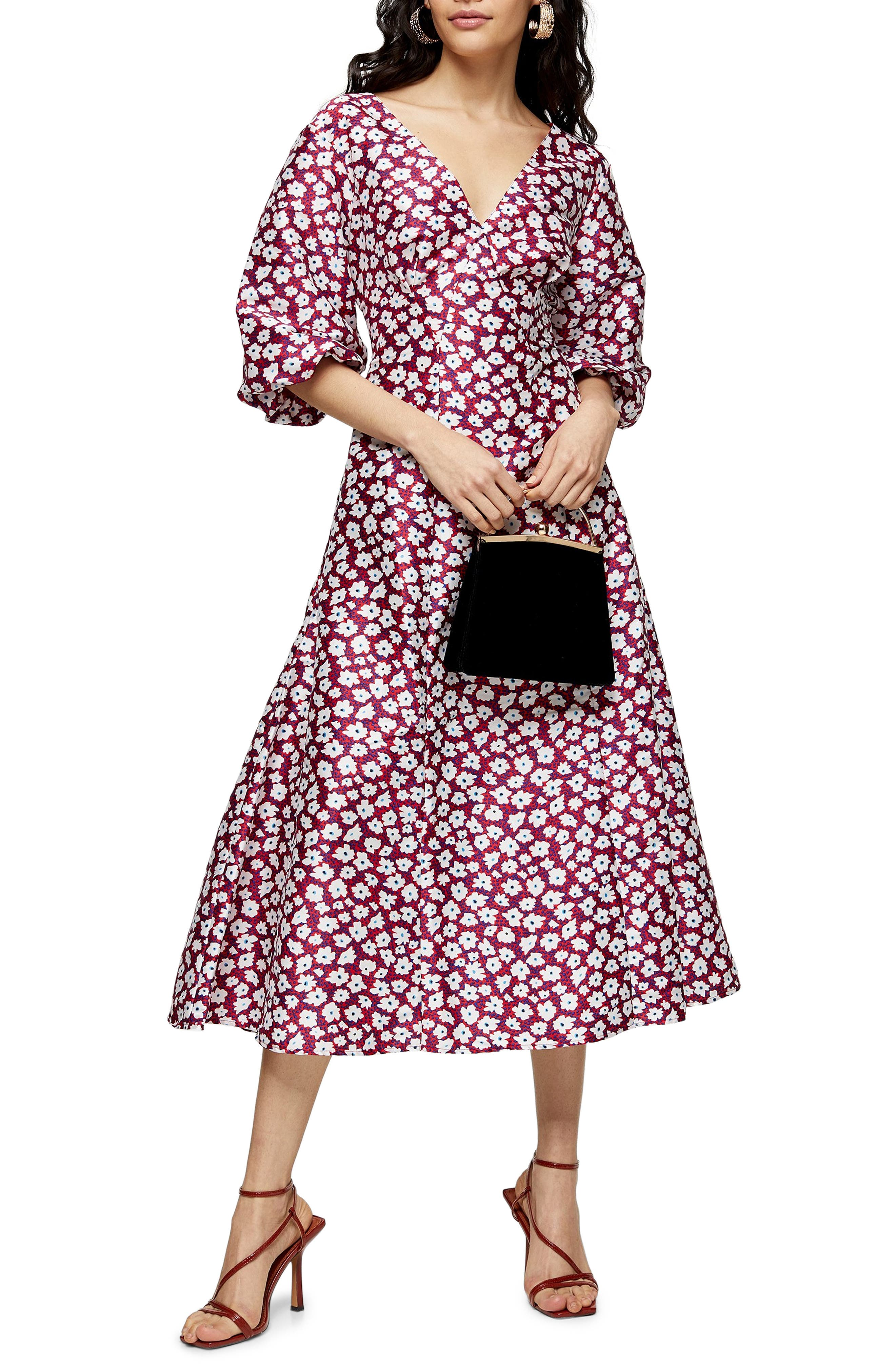 A sleek silhouette defines a gorgeous midi dress sprinkled in daisies and finished with a generous, striking tie at the back. Style Name: Topshop Daisy Print Puff Midi Dress. Style Number: 6052344. Available in stores.