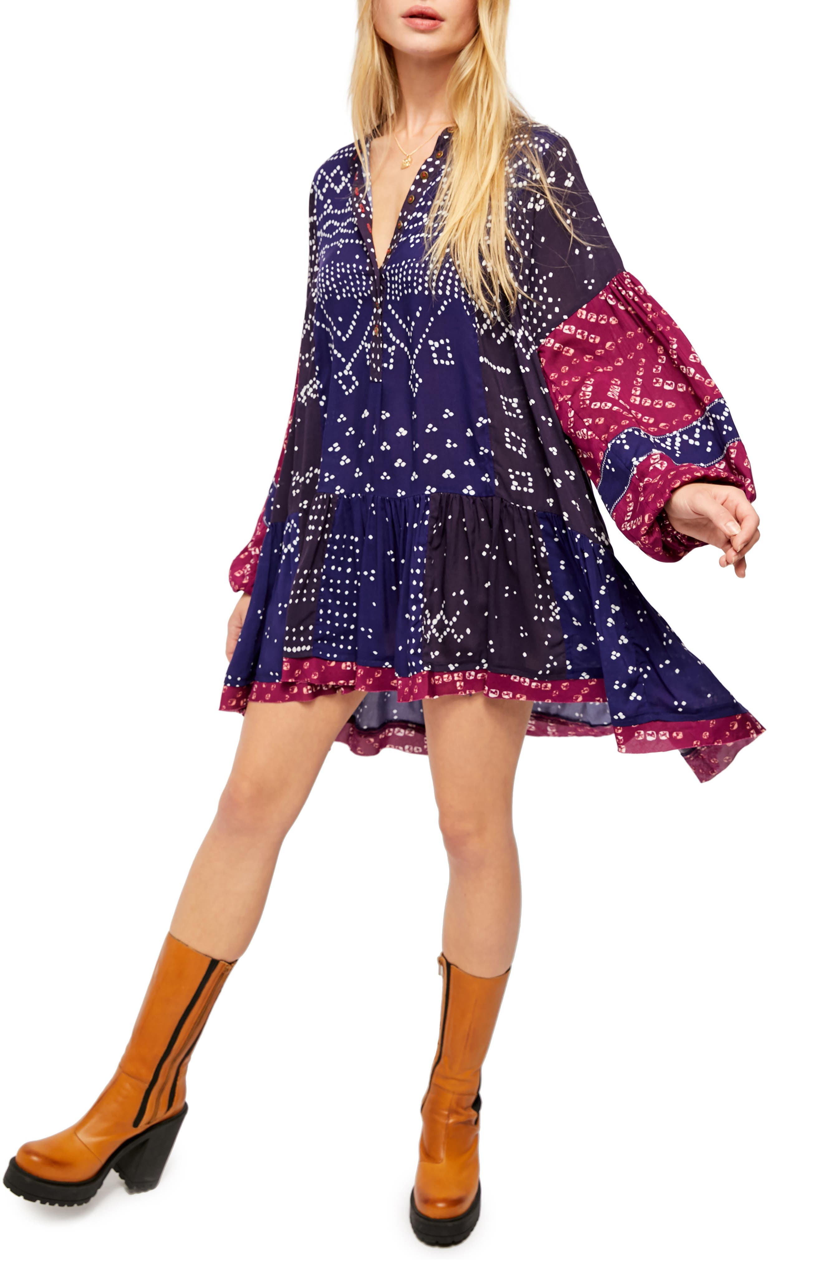 Let your free spirit shine in this drapey ruffle-hem tunic styled with billowed sleeves and a lively boho print. Style Name: Free People Shibori Long Sleeve Tunic Dress. Style Number: 6011072. Available in stores.