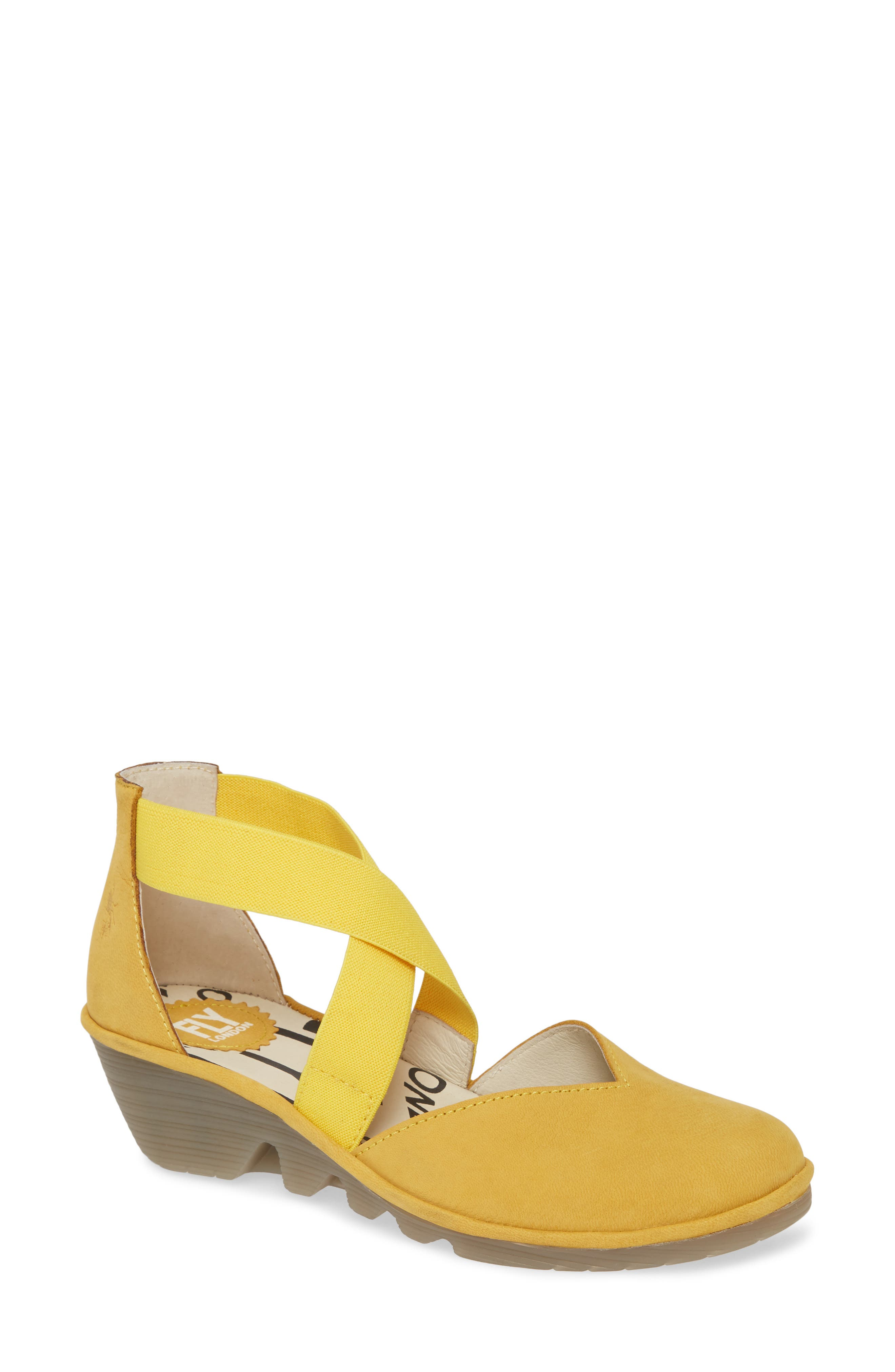 Criss-crossing elastic straps perfect the fit of a well-cushioned wedge grounded by a lightweight and flexible sole. Style Name: Fly London Paco Wedge (Women). Style Number: 5960920 1. Available in stores.