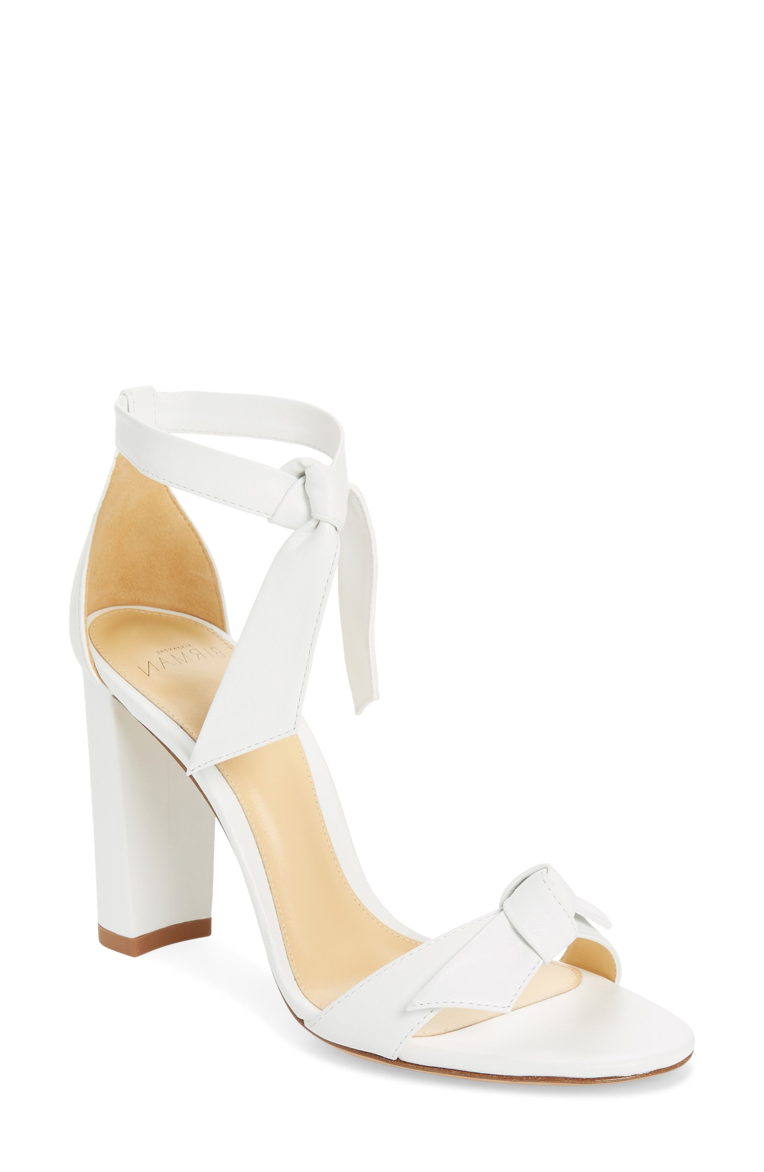 Pre-order this style today! Add to Shopping Bag to view approximate ship date. You\\\'ll be charged only when your item ships. Knotted ties detail the toe strap of an elegant sandal lifted by a covered block heel and tied off with adjustable wraparound straps. Style Name: Alexandre Birman Clarita Block Heel Sandal (Women). Style Number: 5947738. Available in stores.