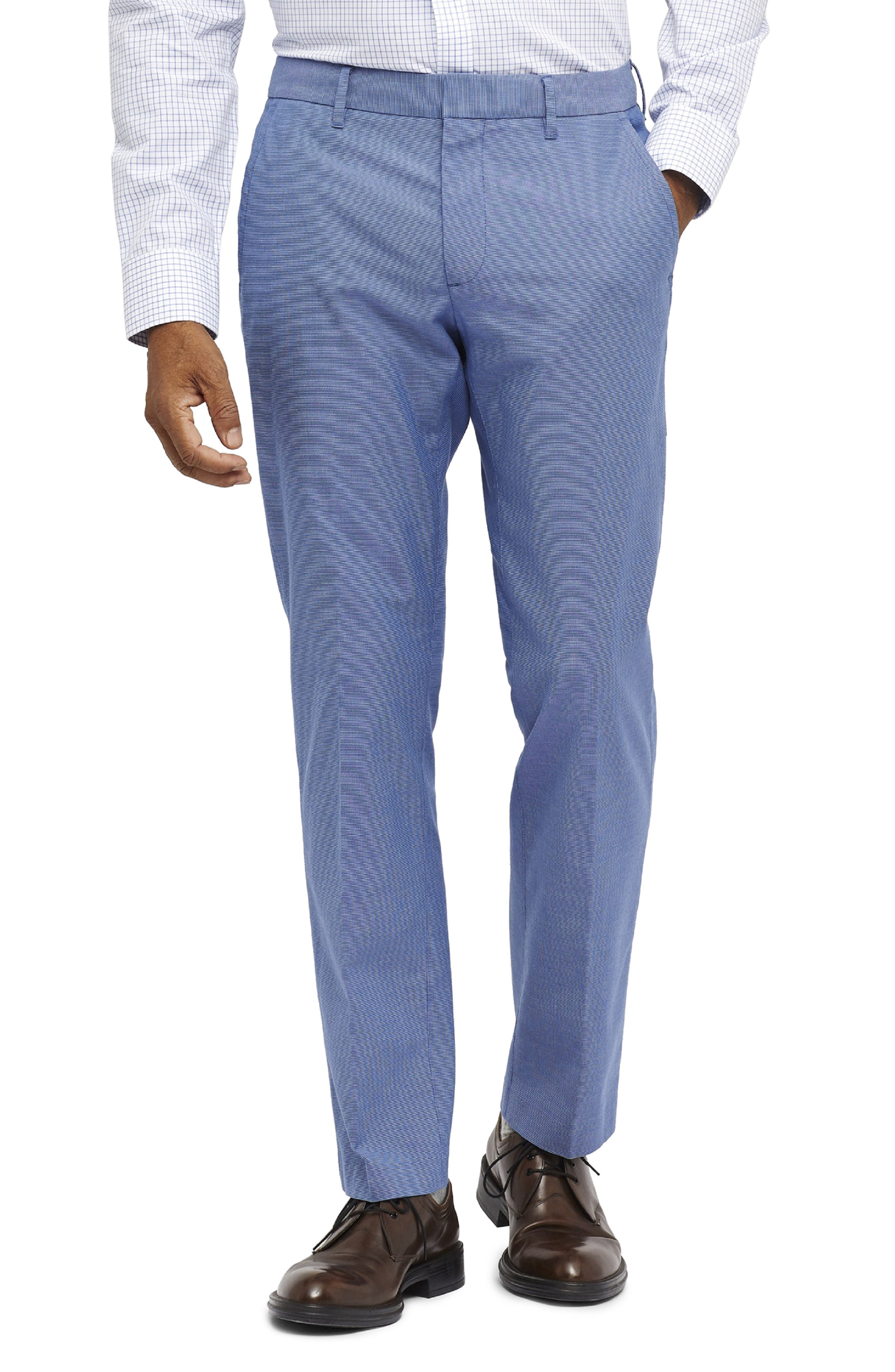 A sharp look for any day of the week, these flat-front pants feature a trim (but not tight) fit and a finish of soft, easy-care stretch cotton. Style Name: Bonobos Weekday Warrior Tailored Fit Stretch Pants. Style Number: 5904101. Available in stores.