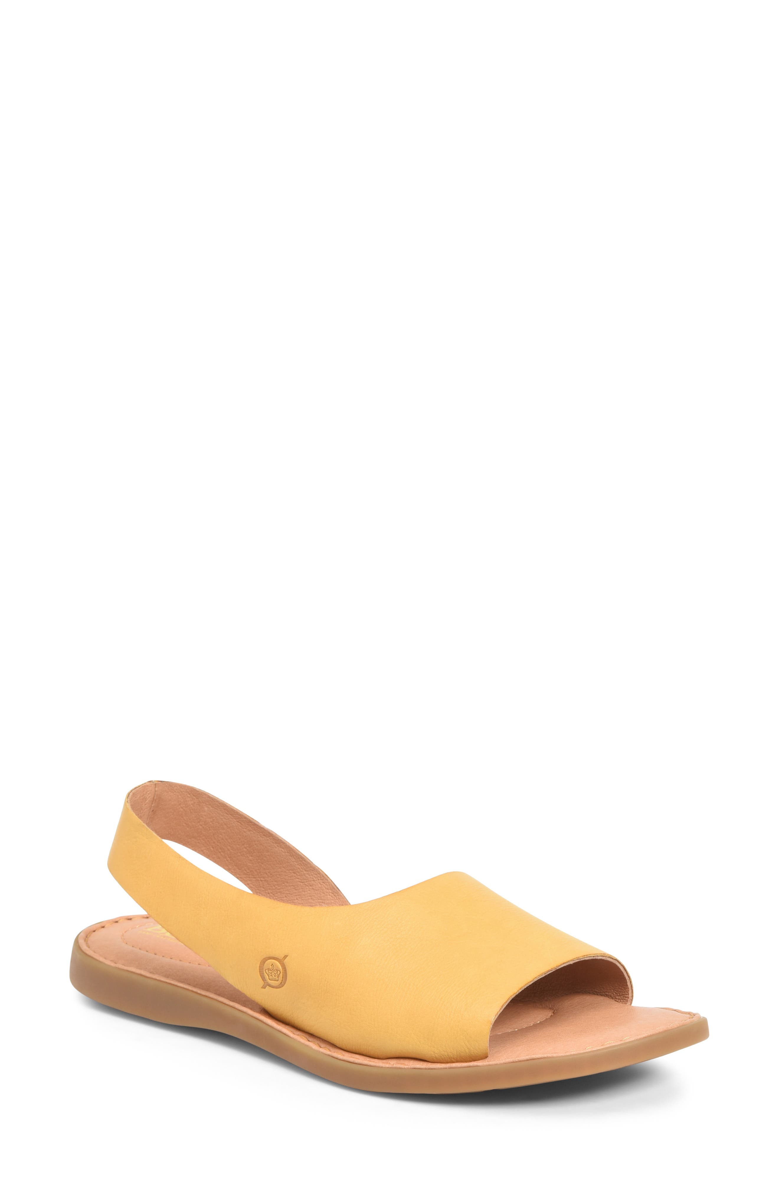 Asymmetrical styling and a streamlined design define this comfortably cushioned sandal grounded by curlicue-shaped treads that leave pretty footprints. Style Name:B?rn Inlet Sandal (Women). Style Number: 6021653. Available in stores.