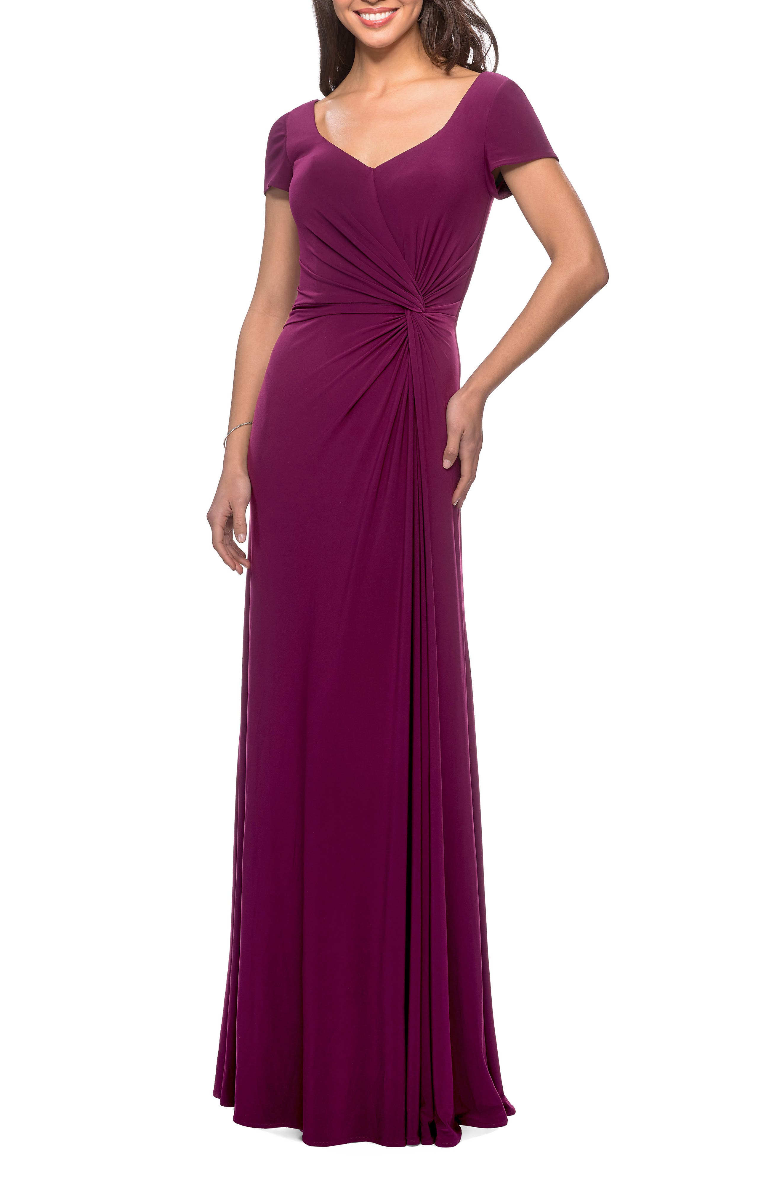 An A-line gown with modern elegance and simplicity is made of fluid jersey with a face-framing sweetheart neckline and a twist of fabric whittling the waist. Style Name: La Femme Twist Front Jersey Gown. Style Number: 5877413. Available in stores.
