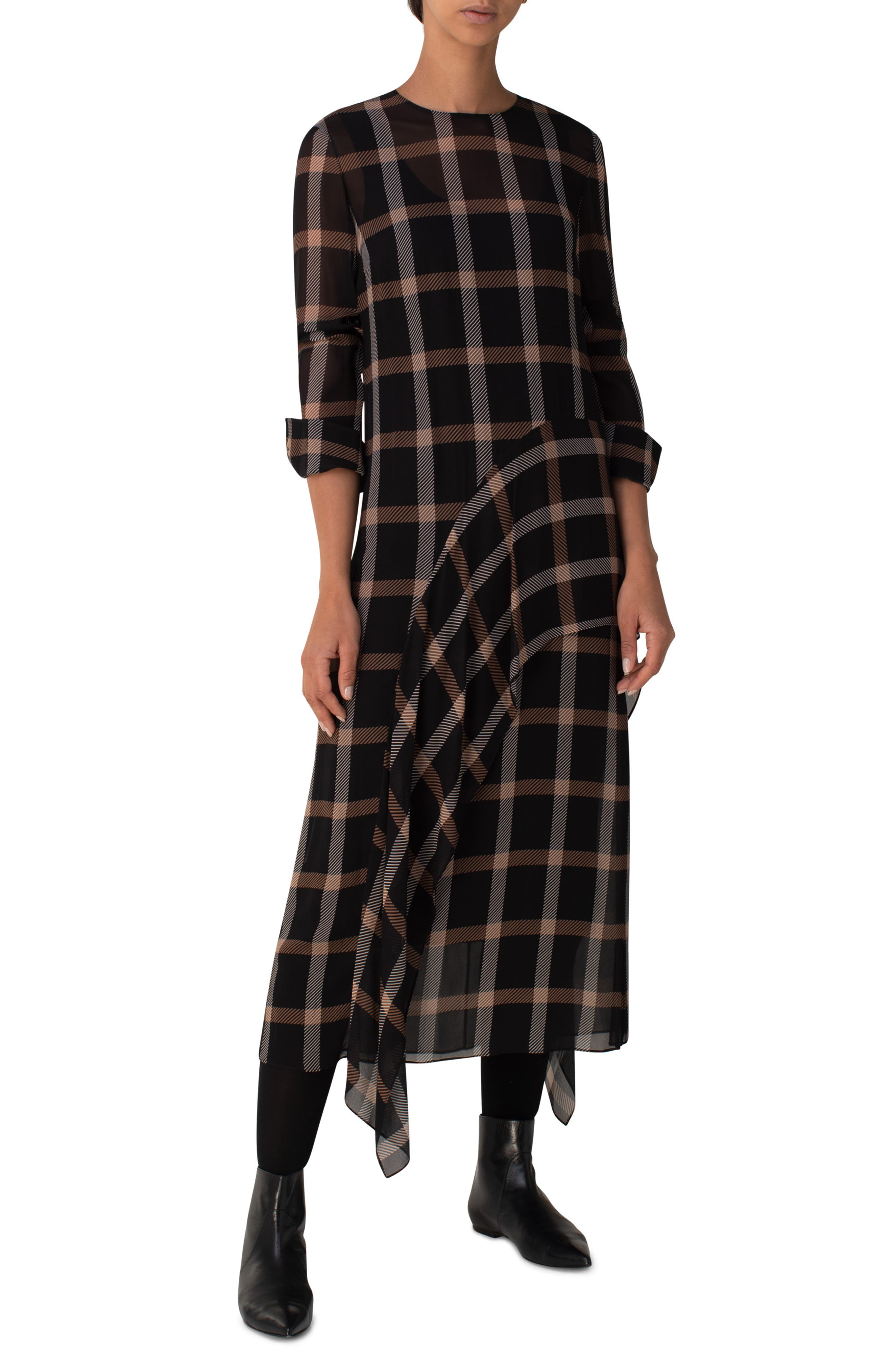 Bias seaming fashions the fluttery, asymmetrically draped skirt of this semi-sheer woven dress patterned with bold windowpane checks. Style Name: Akris Punto Windowpane Check Long Sleeve Midi Dress. Style Number: 6046472. Available in stores.