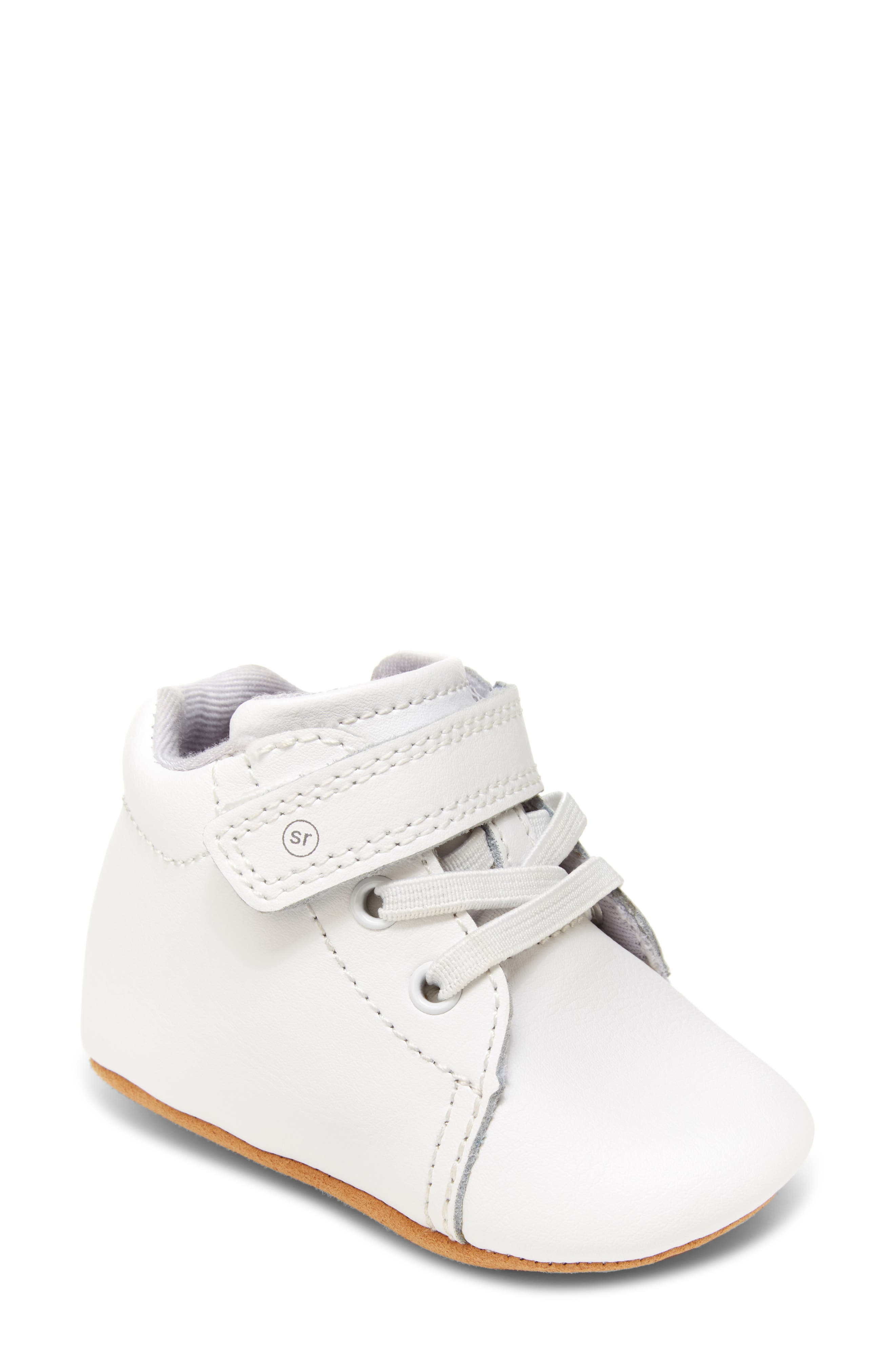A softly supportive upper with easy, rounded edges keeps baby comfortably supported while taking those tentative first steps. A nonslip brand logo on the textile sole helps keep your little one confidently striding. Style Name: Stride Rite Elliot Bootie (Baby). Style Number: 6169760. Available in stores.
