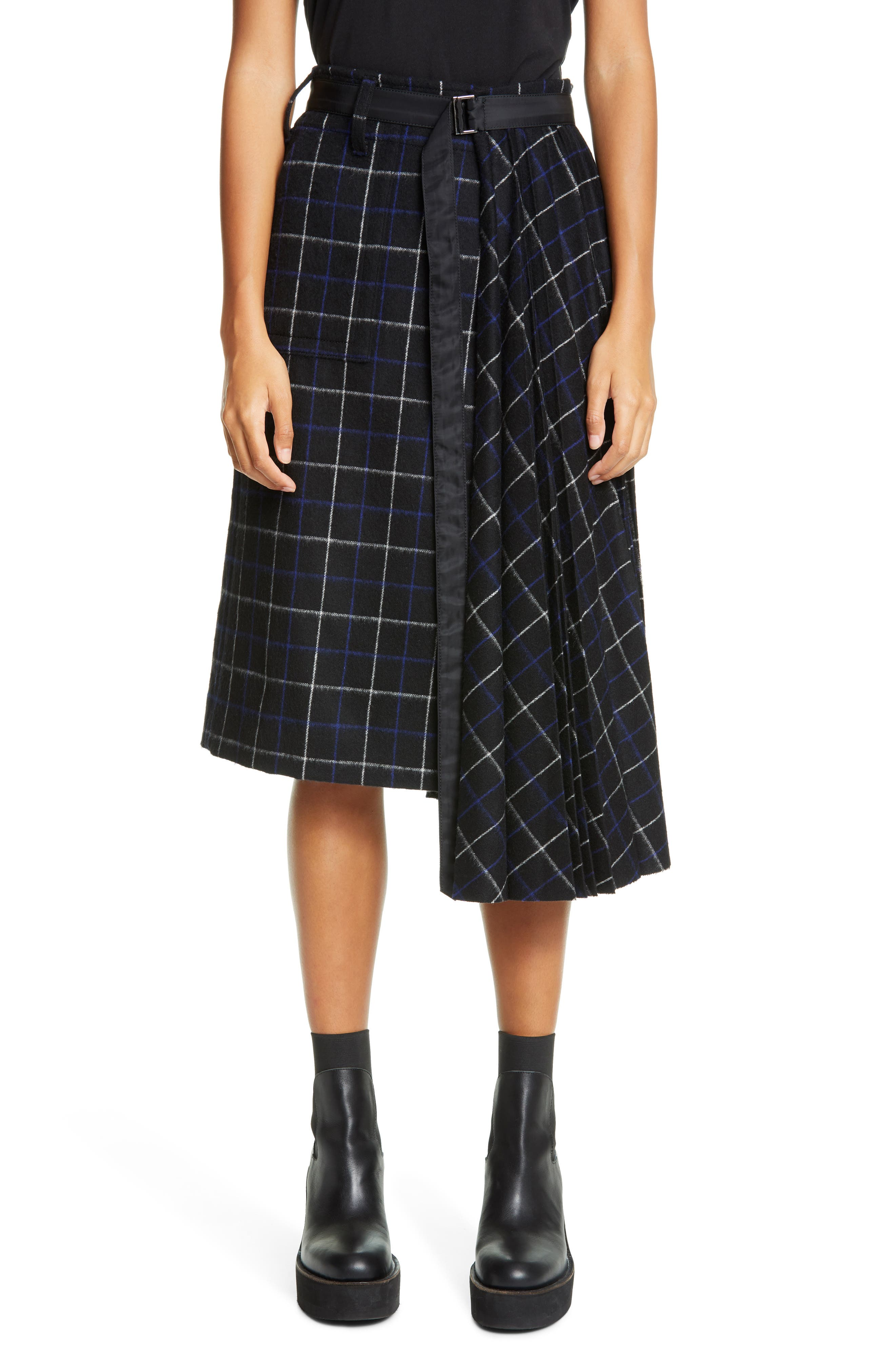 Crisp pleats stream from one end of this plaid skirt cinched tight at the waist with a long, wispy belt, giving this schoolgirl-inspired piece some sporty ease. Style Name: Sacai Asymmetrical Pleated Windowpane Wool Blend Skirt. Style Number: 6086127. Available in stores.
