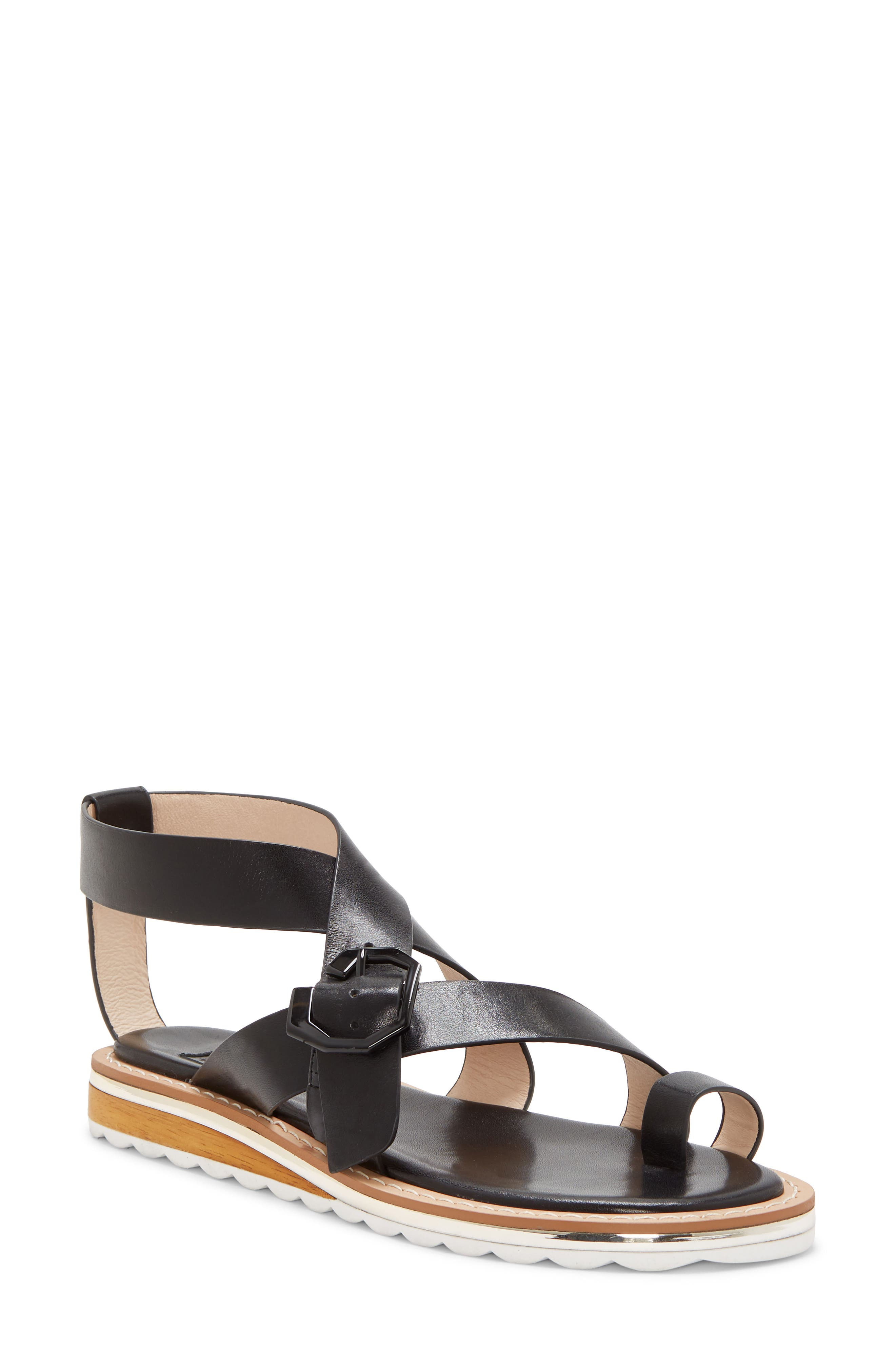 Gladiator style takes a modern turn with this strappy toe-loop sandal accented with metallic trim at the wedge heel. Style Name: Louise Et Cie Esmond Gladiator Sandal (Women). Style Number: 6017210 1. Available in stores.