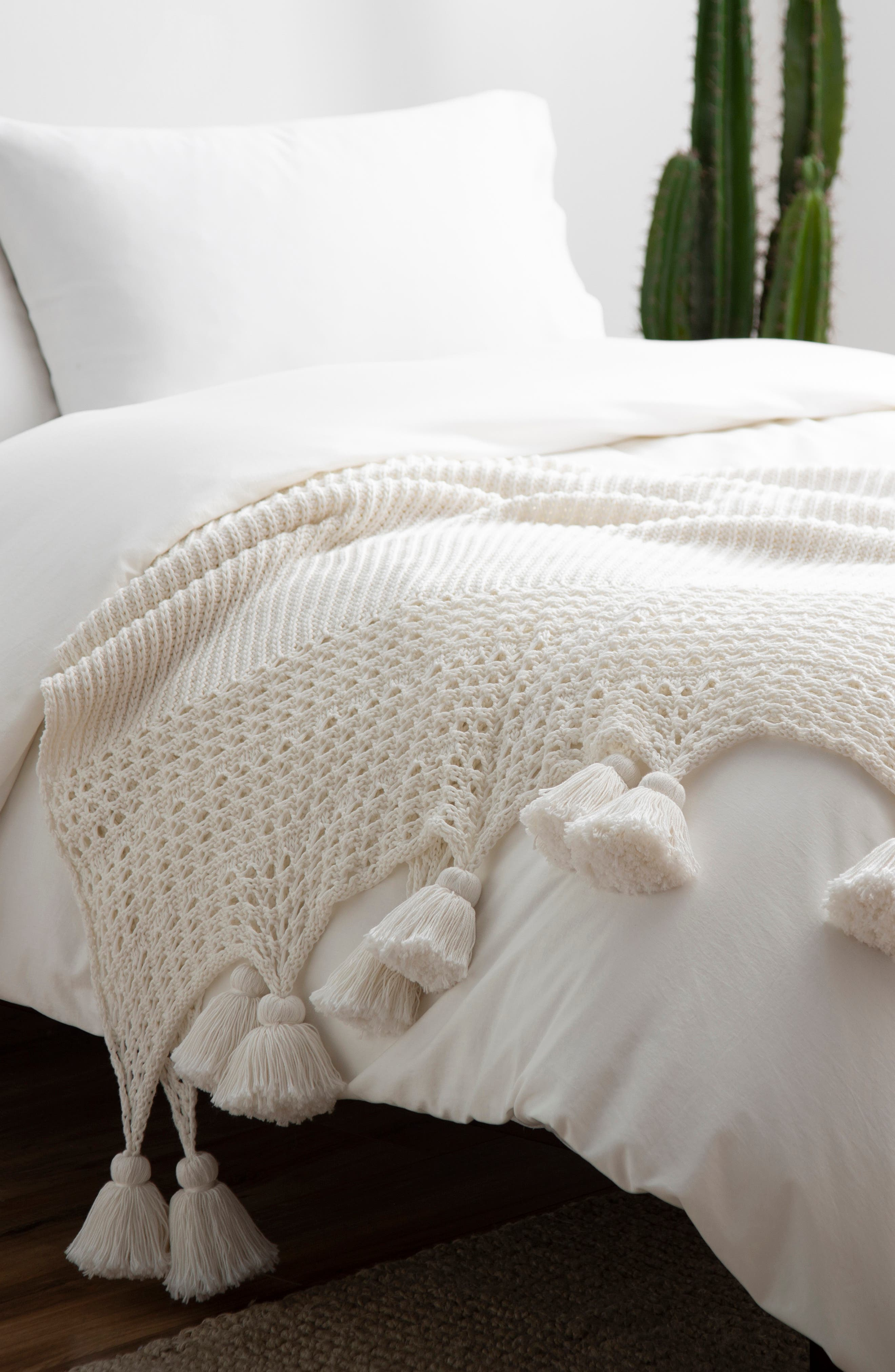Elevate your living space and wrap yourself up in warmth with this beautifully knit throw finished with plush tassel trim. Style Name: UGG Oana Tassel Throw Blanket. Style Number: 6070527. Available in stores.