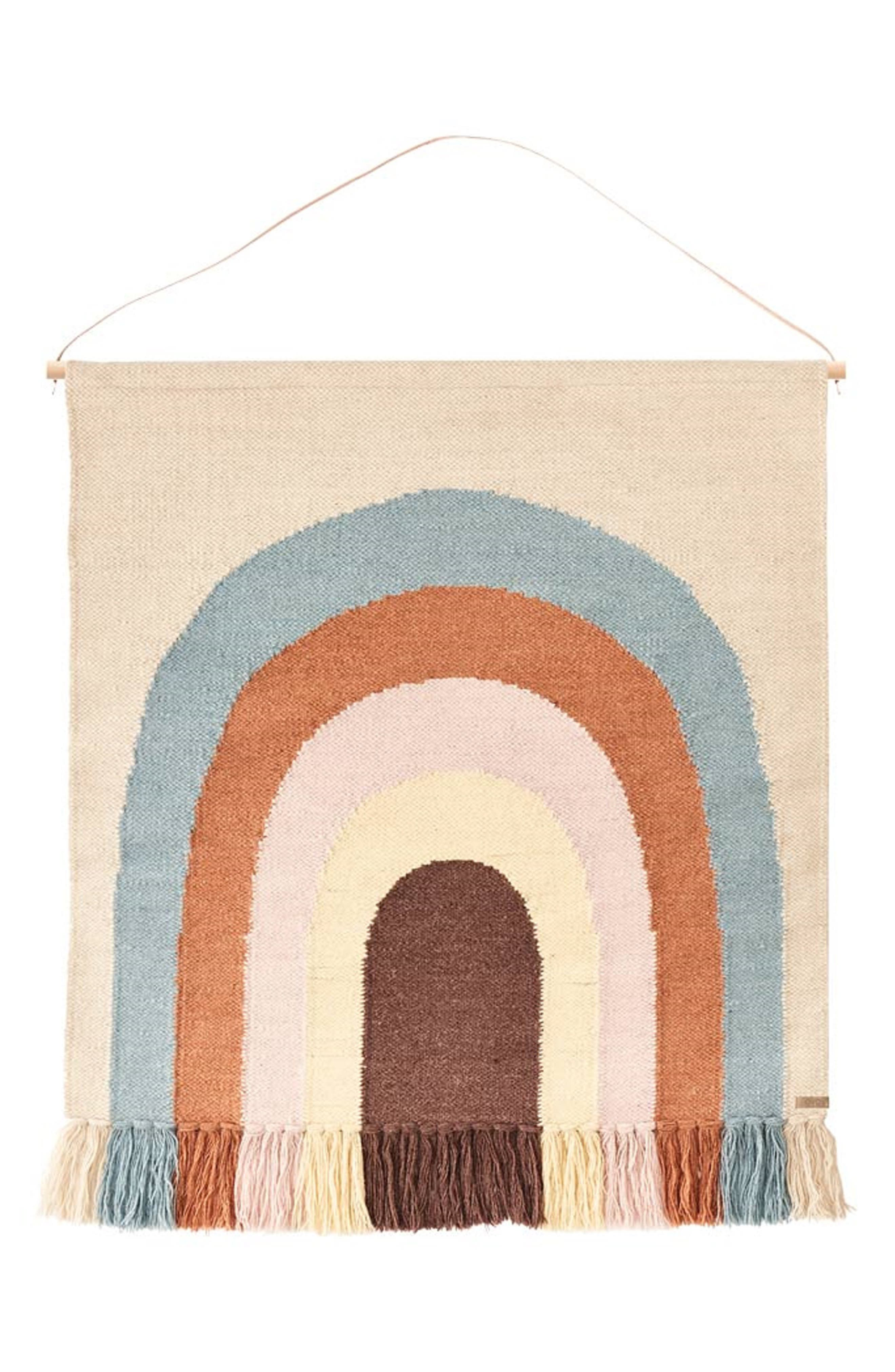 The Danish design brand brings the joy of rainbows indoors with this colorful, fringe-trimmed wall hanging woven from wool and cotton yarns. Style Name: Oyoy Follow The Rainbow Wall Hanging. Style Number: 6158504. Available in stores.