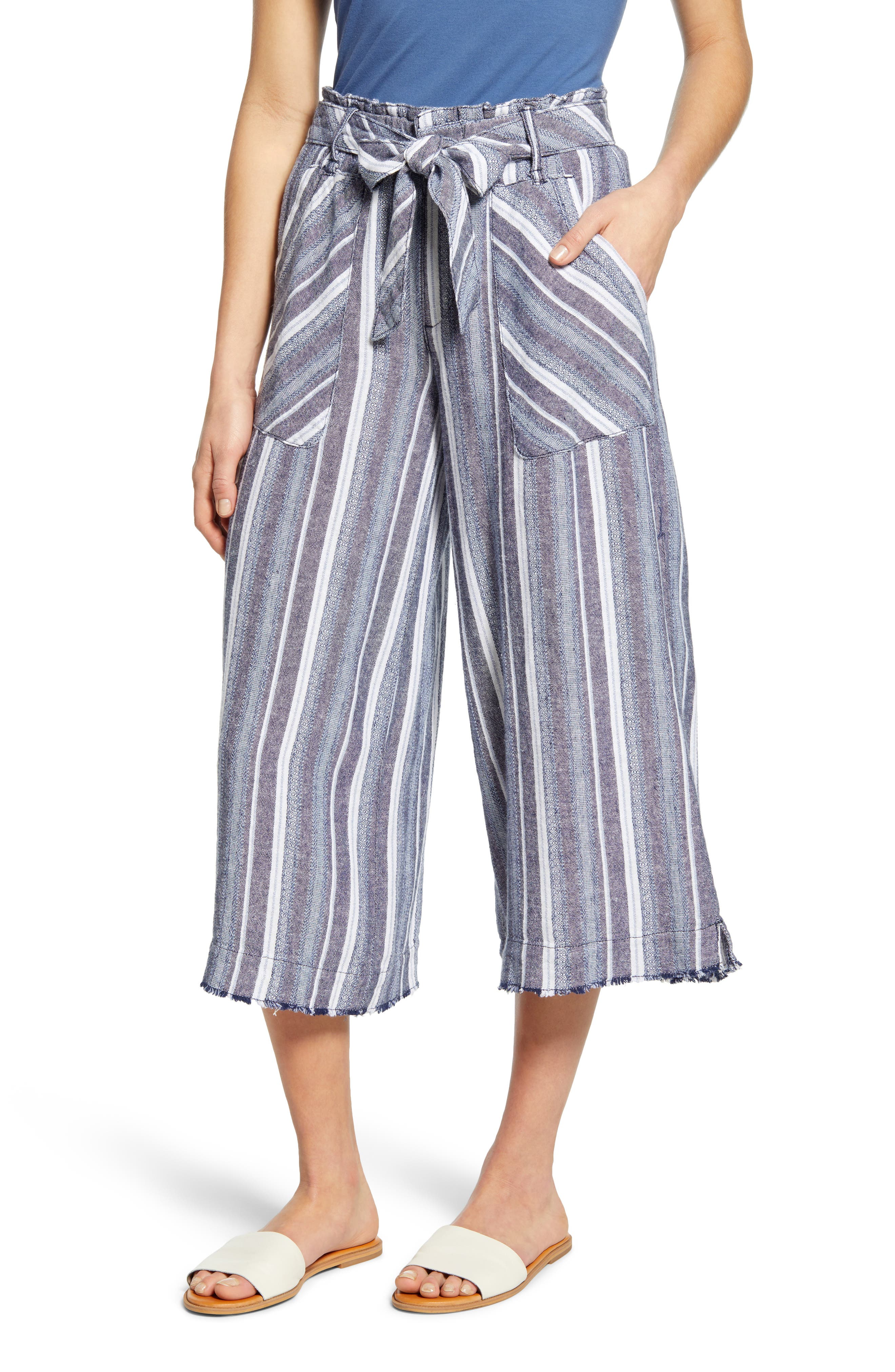 A lightweight linen blend brings a soft feel to fresh wide-leg pants styled with a paperbag waist and a cropped silhouette. Style Name: Wit & Wisdom Paperbag Waist Crop Wide Leg Pants (Nordstrom Exclusive). Style Number: 6012652. Available in stores.