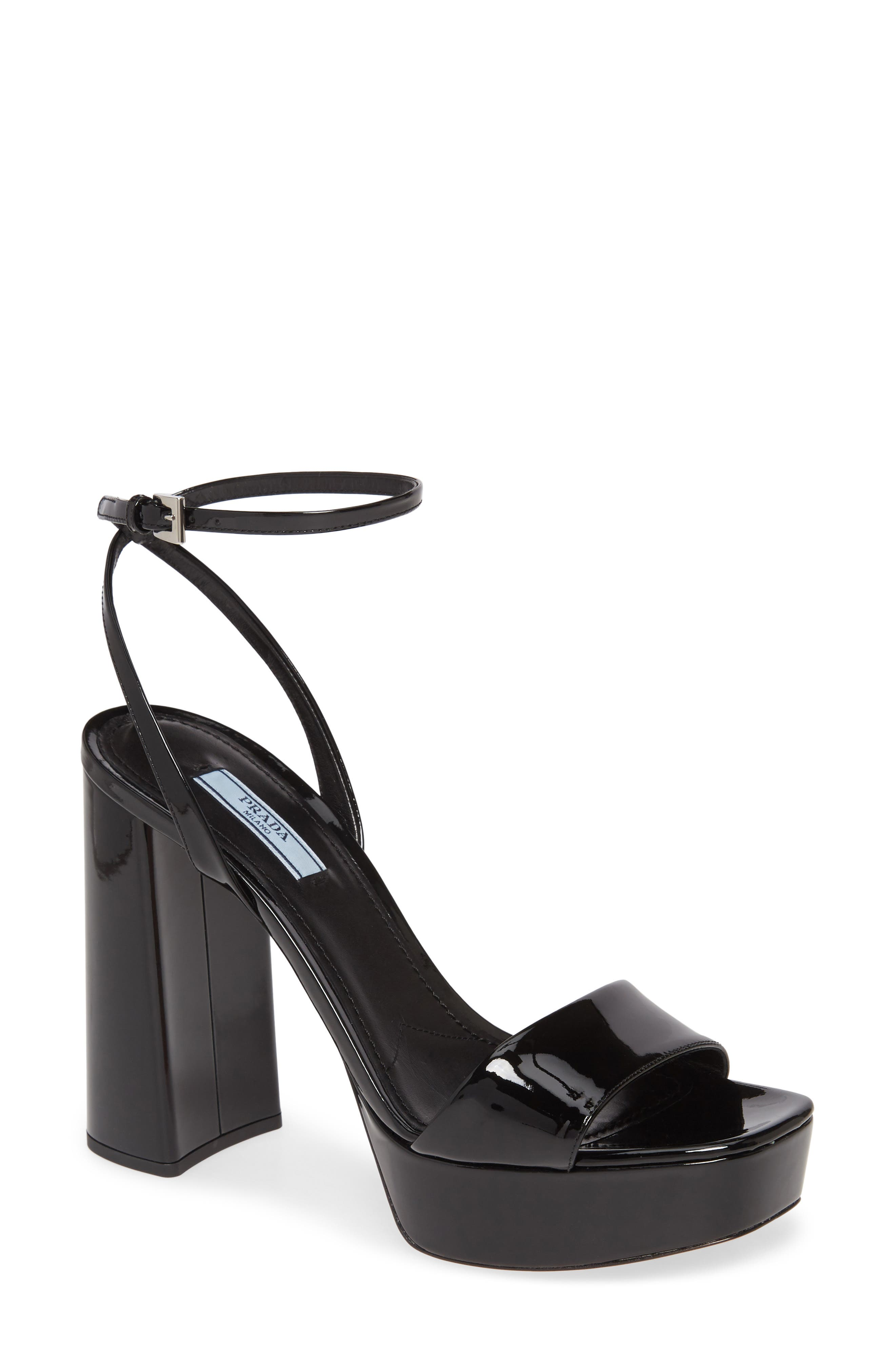 A skyhigh block heel and platform elevate the vintage-inspired vibe of a patent-lambskin sandal that pairs a slender wraparound ankle strap with a blunted toe. Style Name: Prada Ankle Strap Platform Sandal (Women) (Nordstrom Exclusive). Style Number: 5955913. Available in stores.