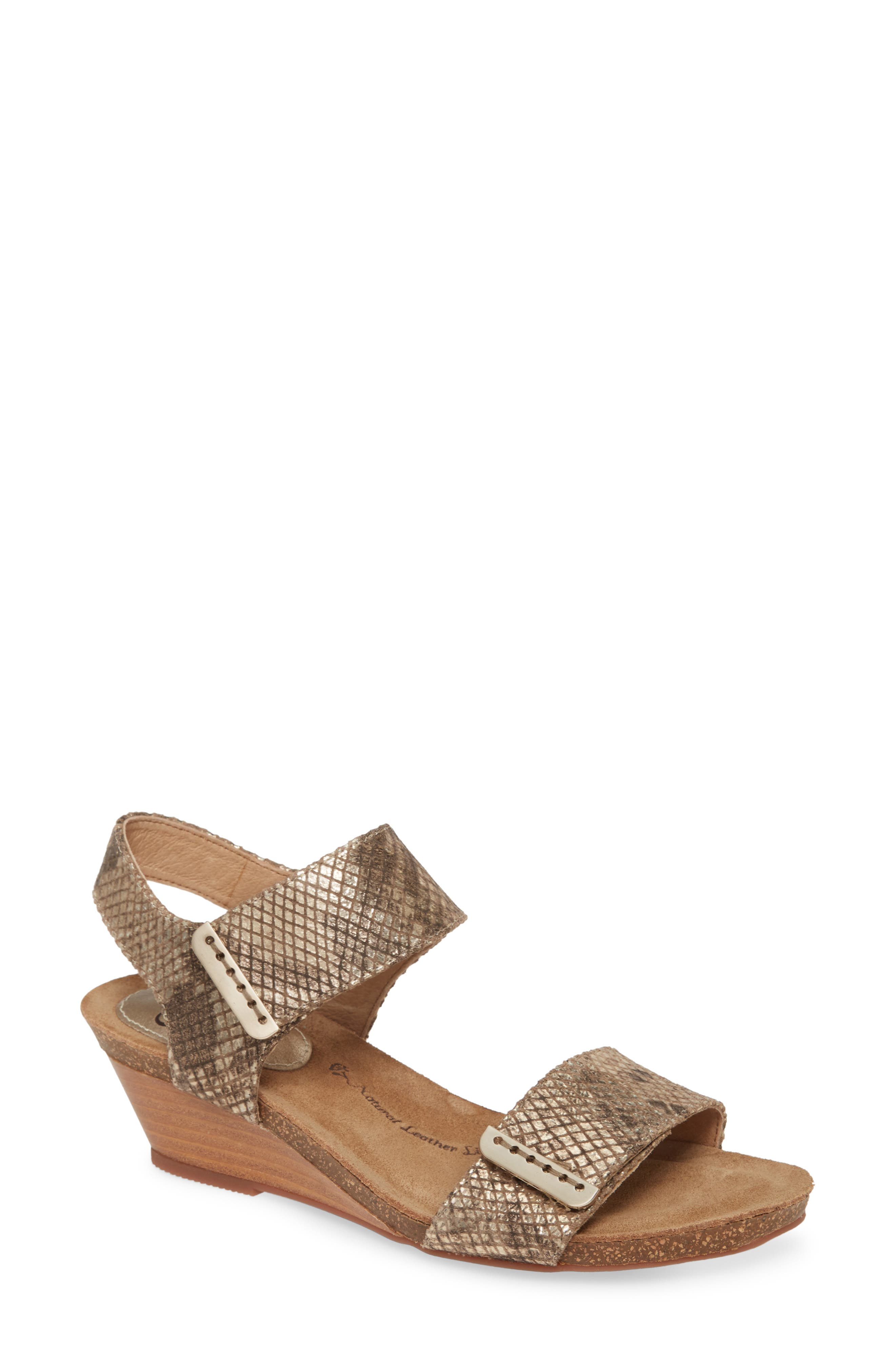 Smooth leather straps add clean, classic style to a wedge sandal grounded by a comfort-cushioned footbed. Style Name: Sofft Verdi Wedge Sandal (Women). Style Number: 5544220 2. Available in stores.