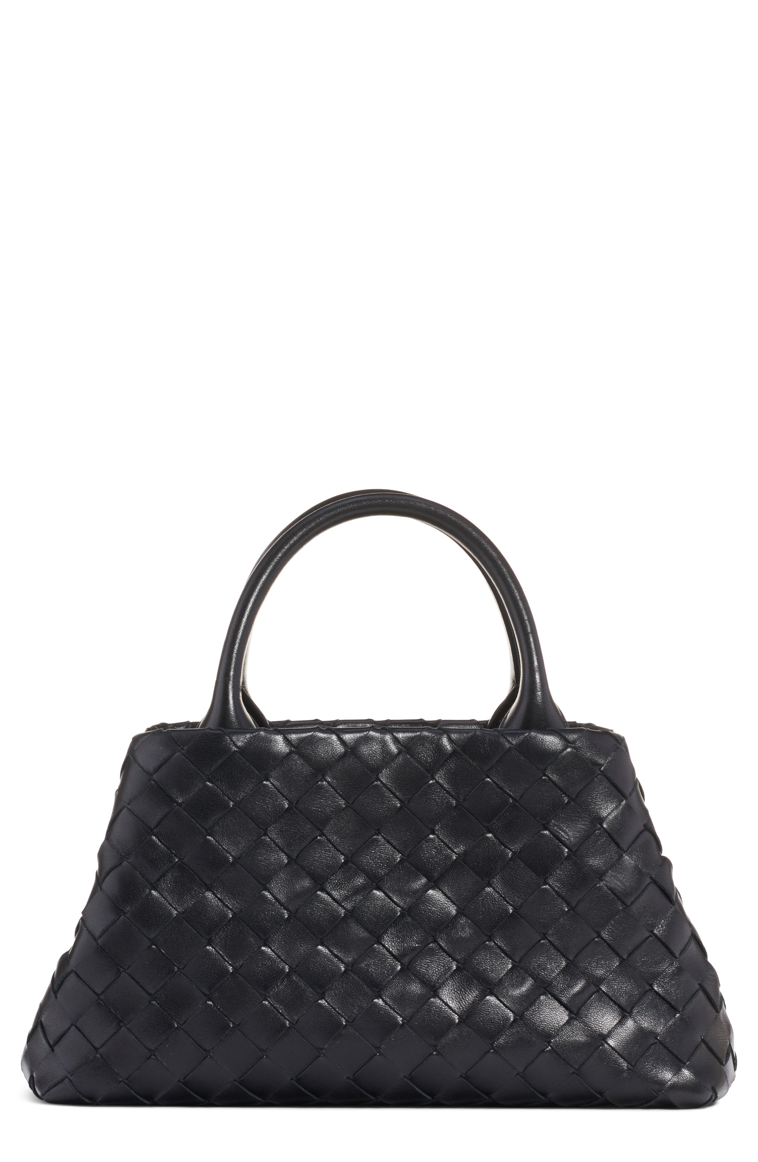 The brand\\\'s iconic intrecciato weave-handwoven strips of lambskin nappa leather-textures this double-handled tote. The divided interior helps keep your daily essentials organized, while the flat base prevents the bag from tipping over when it\\\'s set down. Style Name: Bottega Veneta Mini Intrecciato Leather Double Handle Tote Bag. Style Number: 5946817. Available in stores.
