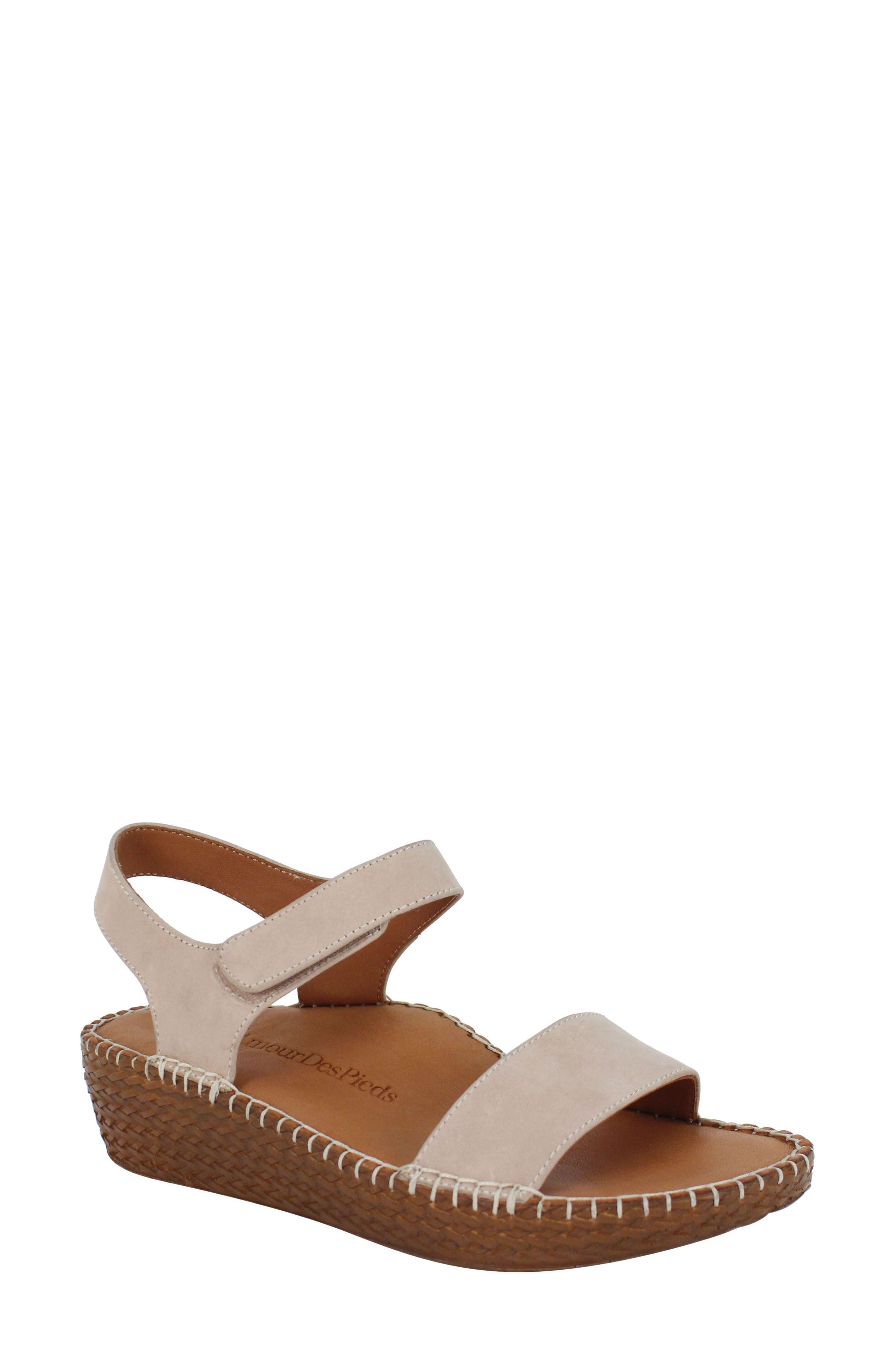 A richly textured wedge heightens the summery appeal of a breezy platform sandal featuring whipstitched trim and a well-cushioned footbed for endless comfort. Style Name:L\\\'Amour Des Pieds Yanis Sandal (Women). Style Number: 6048350. Available in stores.