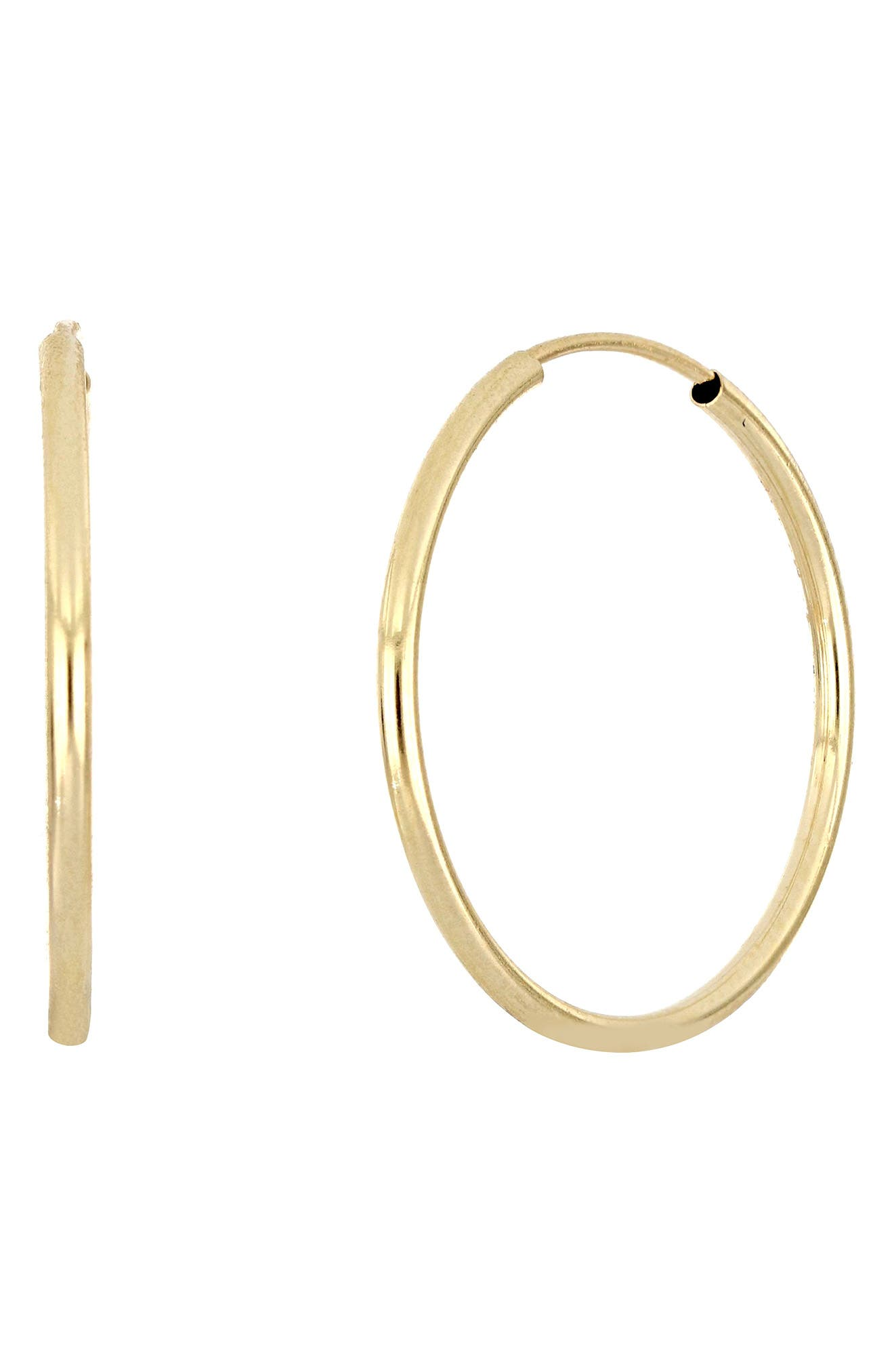 Handcrafted in Italy from 14-karat gold, these slender hoops come in an eternity design that goes with their timeless beauty. Style Name: Bony Levy Eternity Hoop Earrings (Nordstrom Exclusive). Style Number: 6090709. Available in stores.