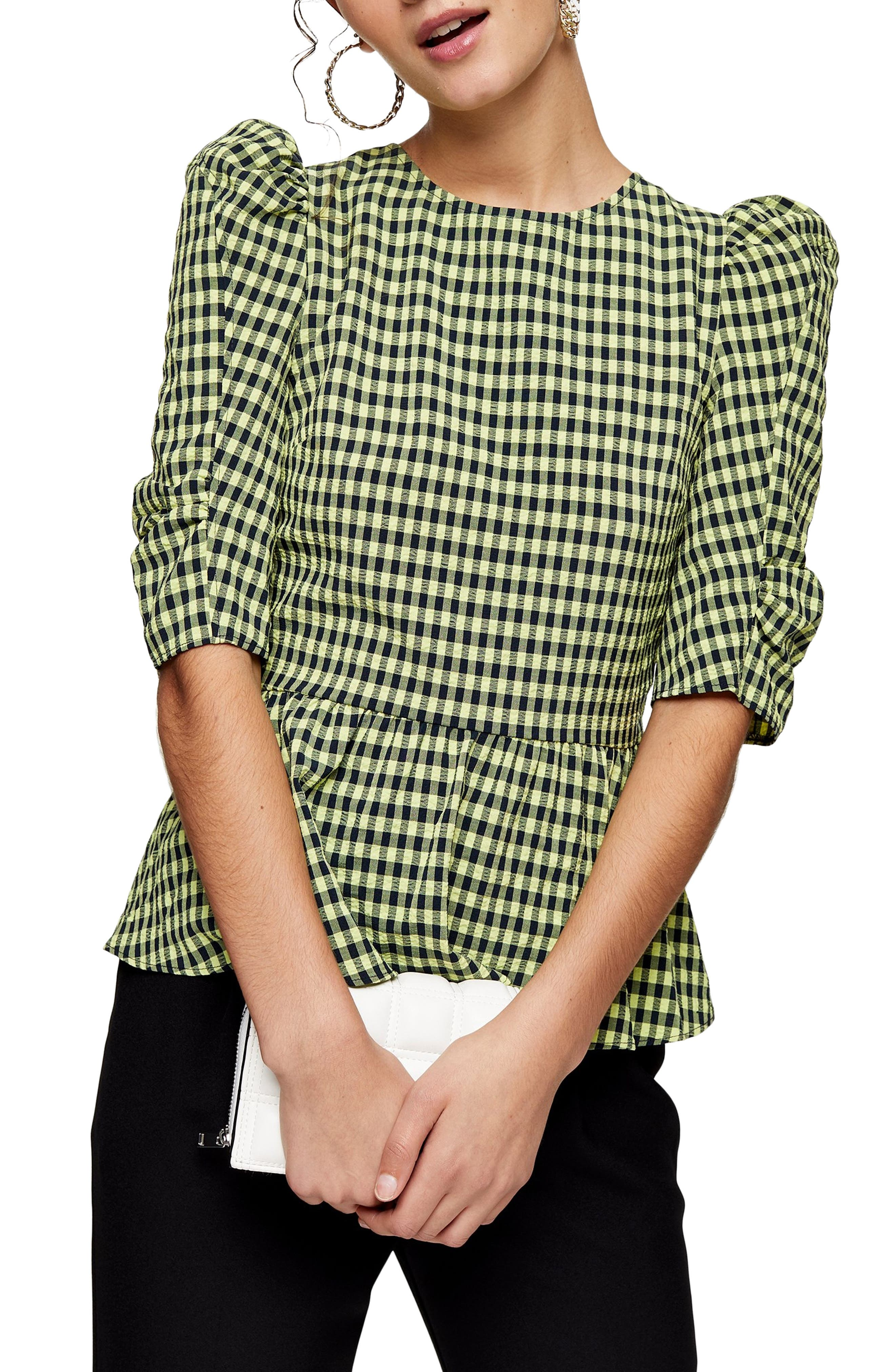 Corset-inspired back lacing adds an alluring finish to a retro-chic gingham blouse fashioned with puffed elbow-length sleeves. Style Name: Topshop Gingham Blouse. Style Number: 6091752. Available in stores.