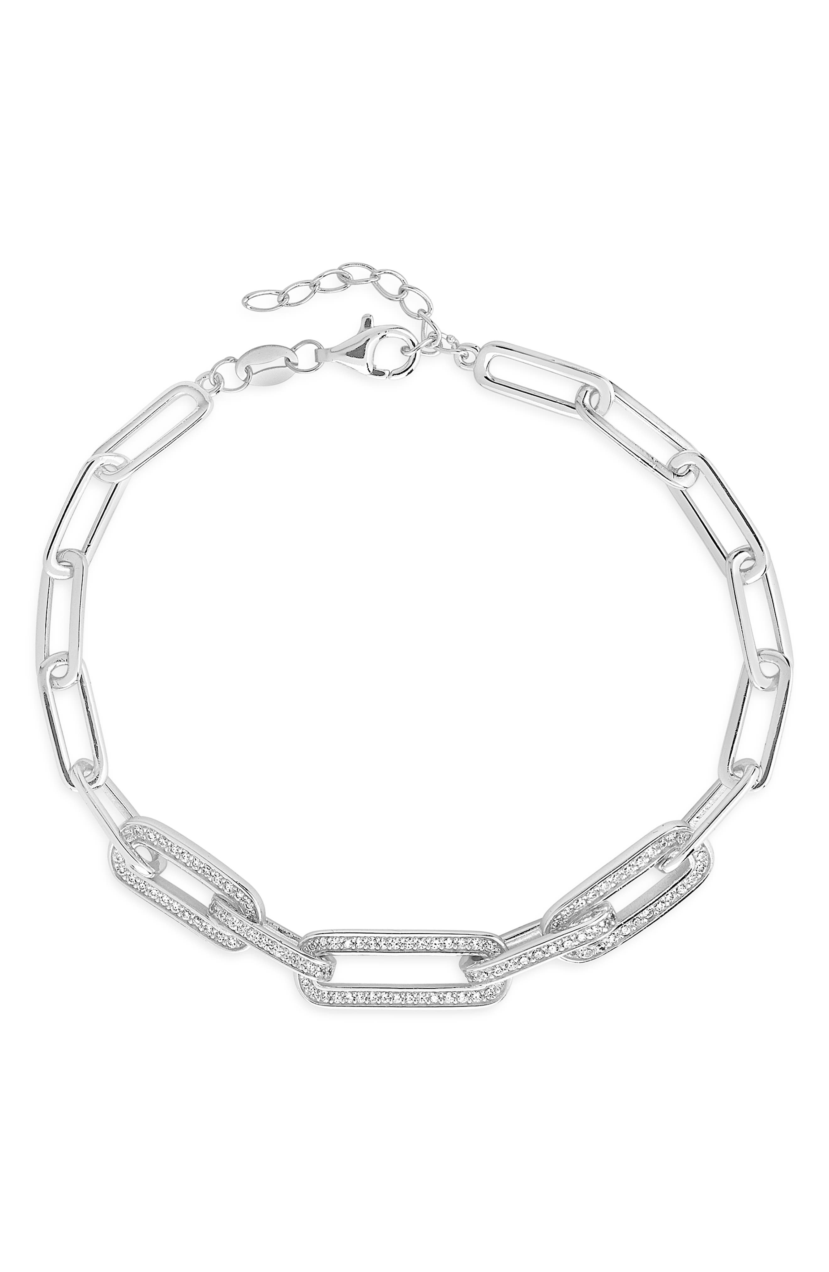 In this modern bracelet, a trio of links is set with glittering cubic zironia to showcase the sparkle right out front. Style Name: Sterling Forever Cubic Zirconia Long Link Bracelet. Style Number: 6114369. Available in stores.