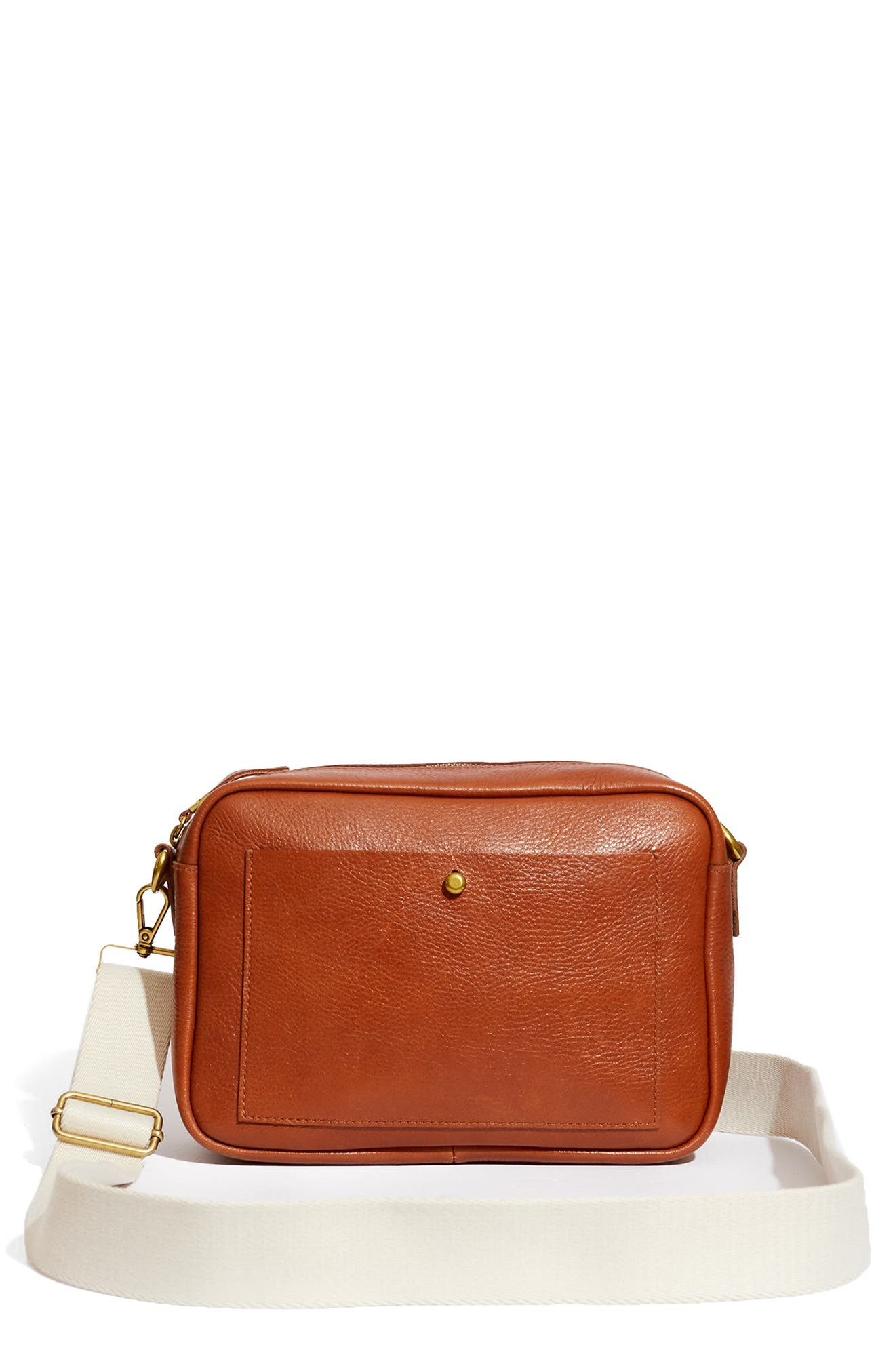 A brand-new take on Madewell\\\'s best seller, this medium-sized structured bag is big enough to fit a book, a water bottle or even your fancy camera. Made of high-quality leather that breaks in beautifully, it\\\'s cool, convenient and customizable with two strap styles to choose from (one\\\'s matching, one\\\'s wide and webbed). Style Name: Madewell The Medium Transport Camera Bag. Style Number: 6088652. Available in stores.
