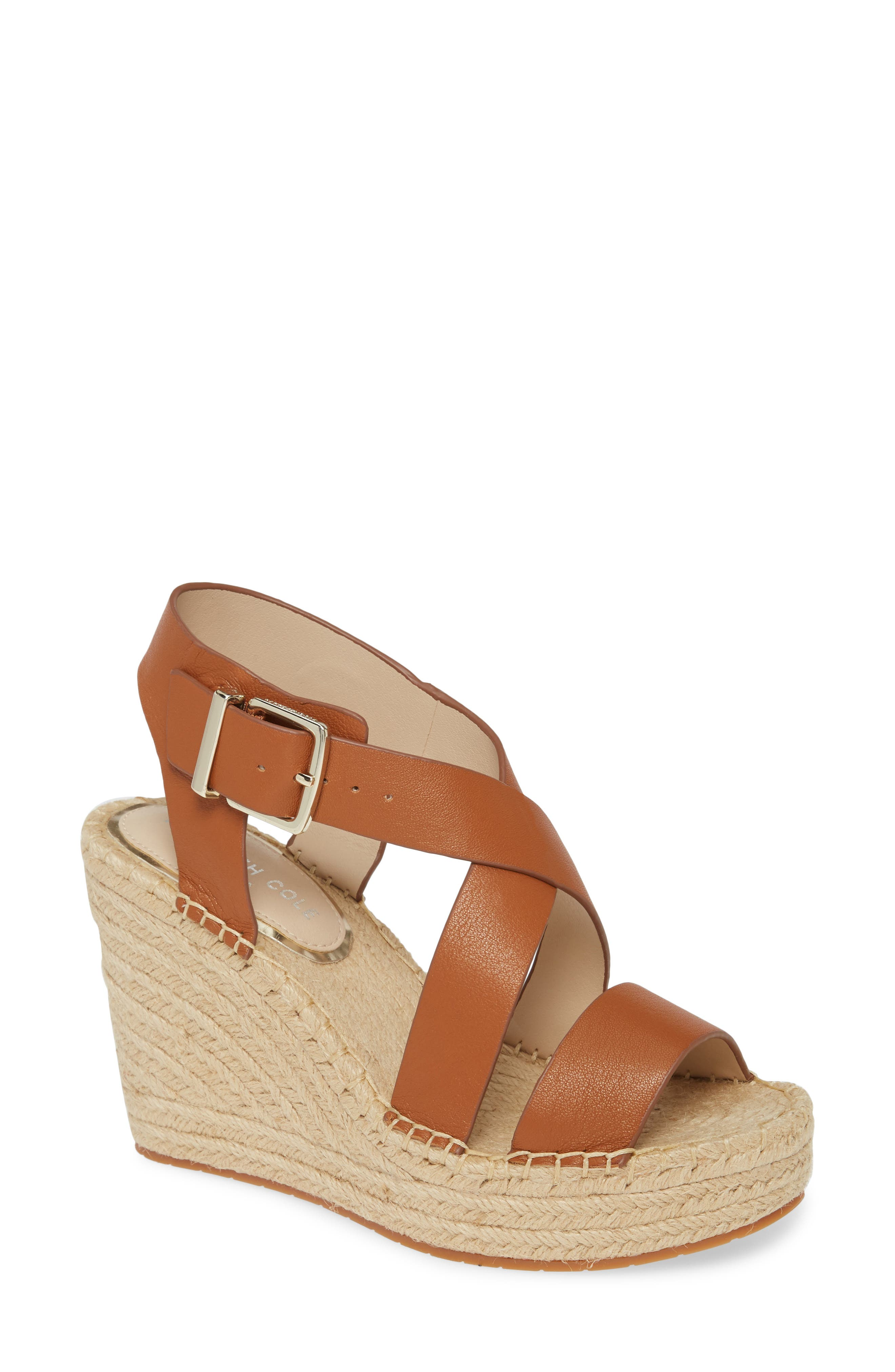 An espadrille-inspired platform sole provides a lofty foundation for this breezy cross-strap sandal. Style Name: Kenneth Cole New York Olivia Espadrille Wedge Platform Sandal (Women). Style Number: 5995736 1. Available in stores.