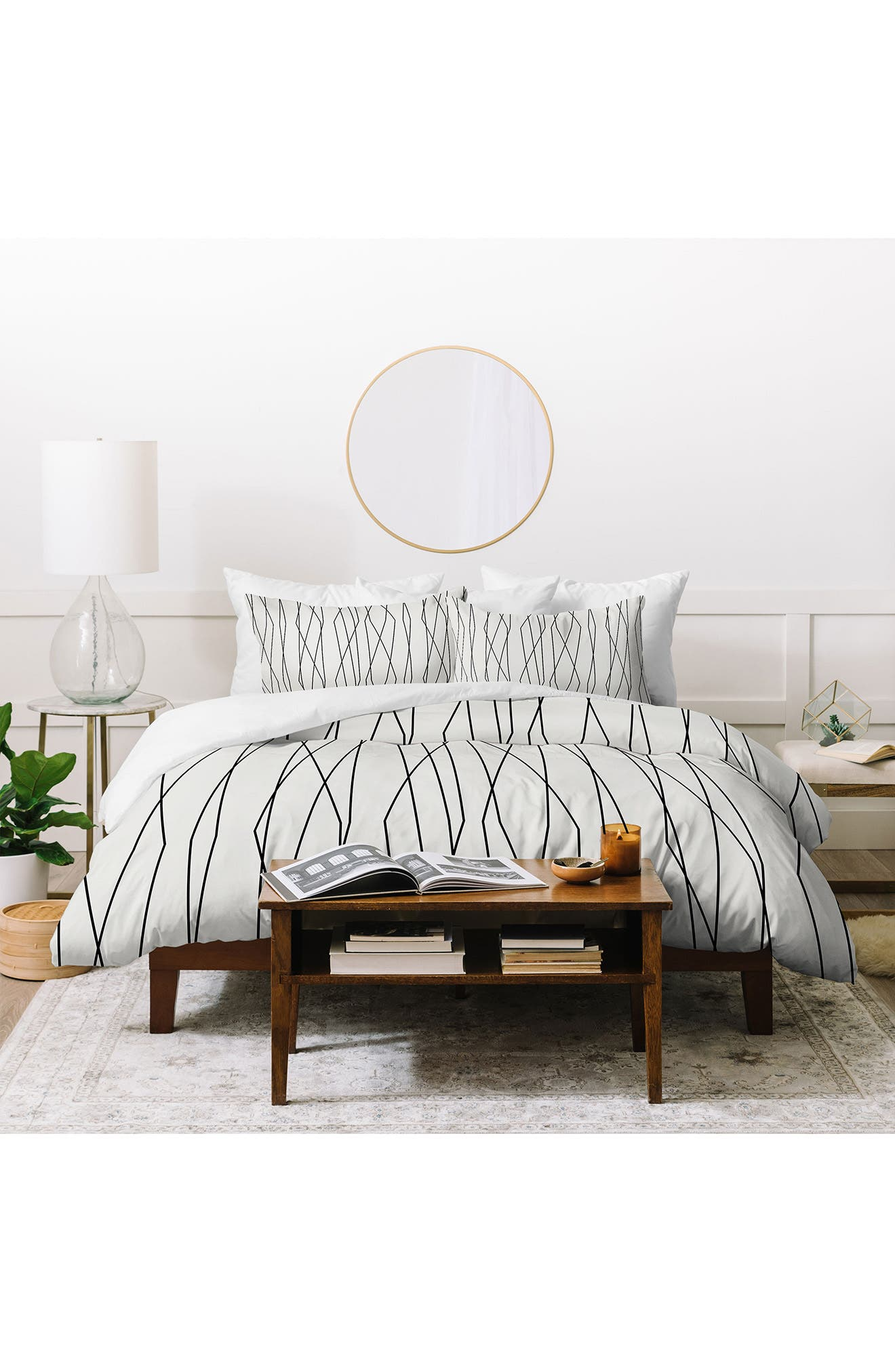 An eye-catching geometric design brings statement-making style to a versatile duvet cover and coordinating shams. Style Name: Deny Designs Heather Dutton Linear Cross Duvet Cover & Sham Set. Style Number: 6083328. Available in stores.