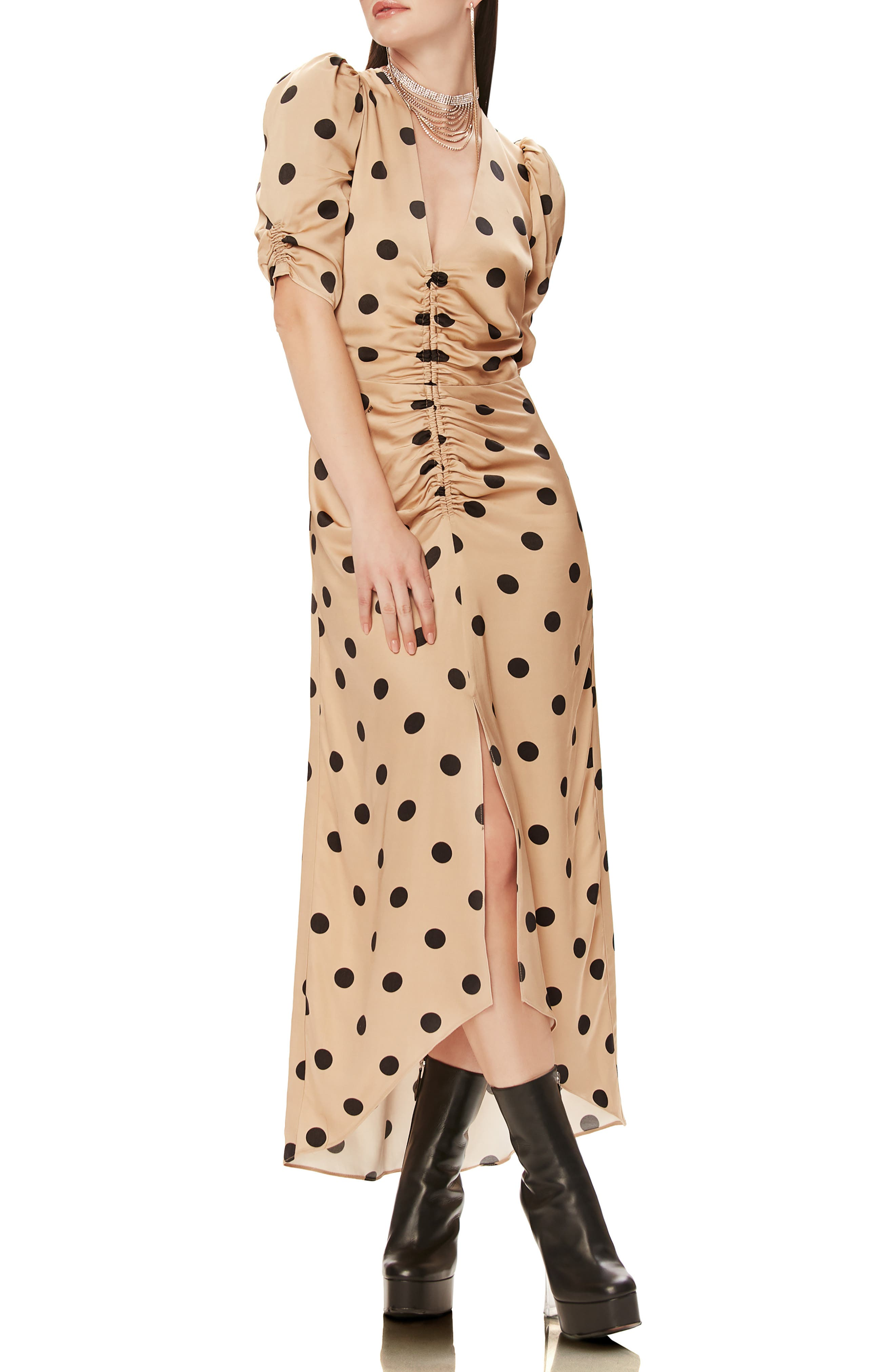 A ruched front and dramatic front slit add flirty, flattering details to a puff-sleeve satin dress in a bold print. Style Name: Afrm Suki Ruched Midi Dress. Style Number: 5971262 1. Available in stores.
