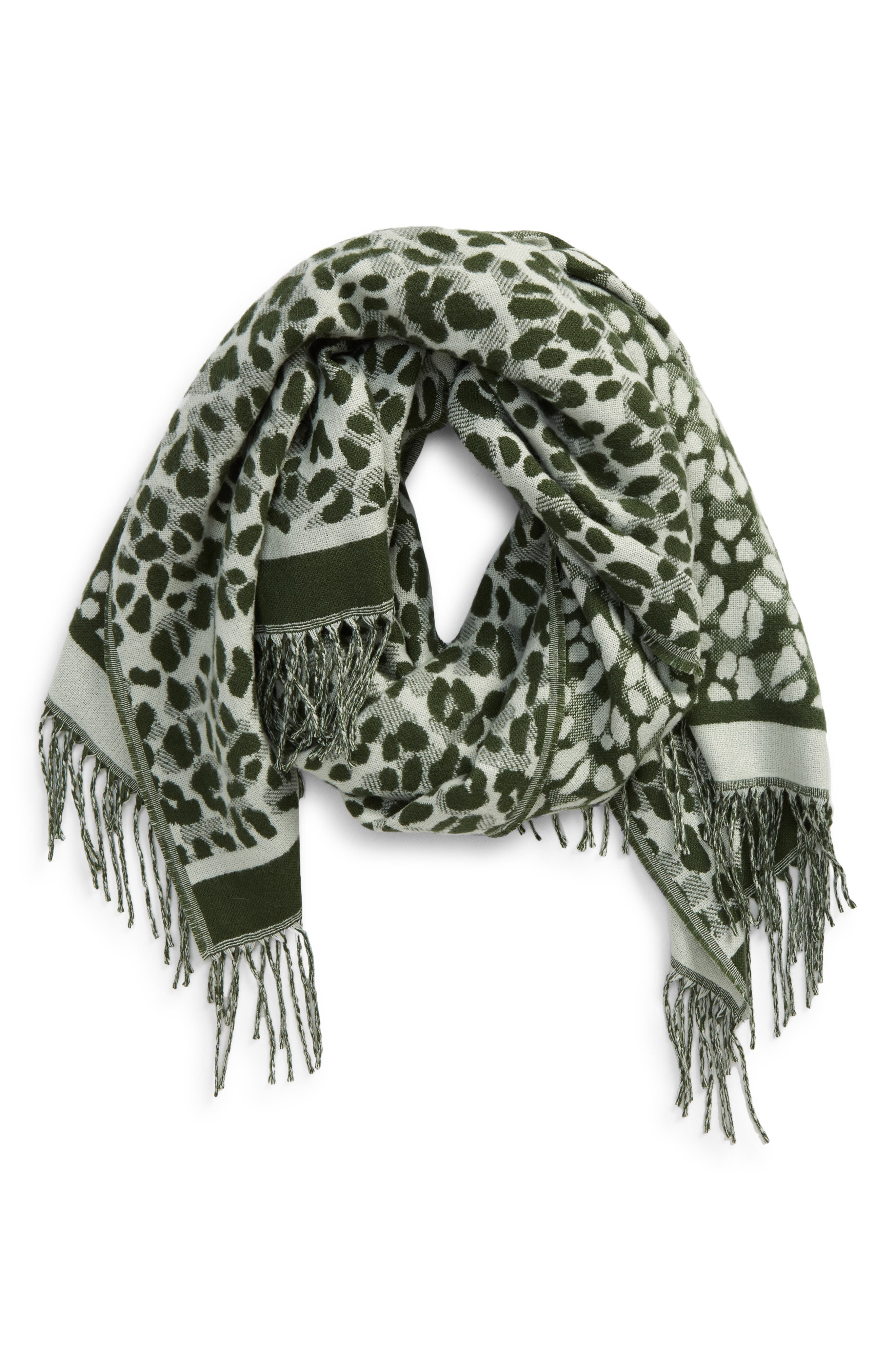 Bring an exotic finishing touch to your cold-weather look with this leopard-print scarf trimmed with long, twisted fringe. Style Name: Ted Baker London Leopard Scarf. Style Number: 5908378. Available in stores.