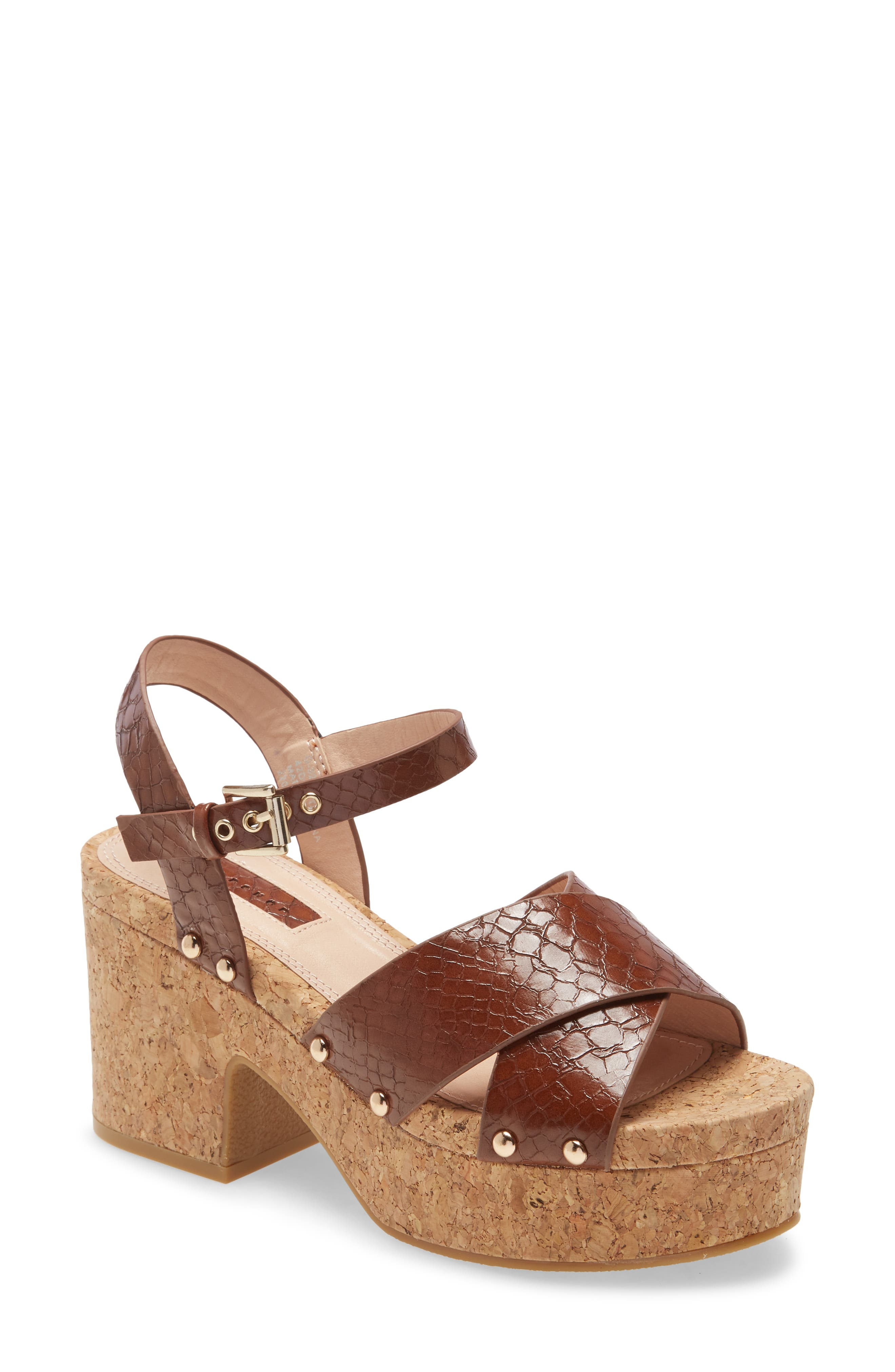 Snakeskin-embossed straps pair with a cork-textured platform sole to kick up the appeal of a sandal that puts chunky vintage vibes under any look. Style Name: Topshop Dancer Platform Sandal (Women). Style Number: 6084294. Available in stores.