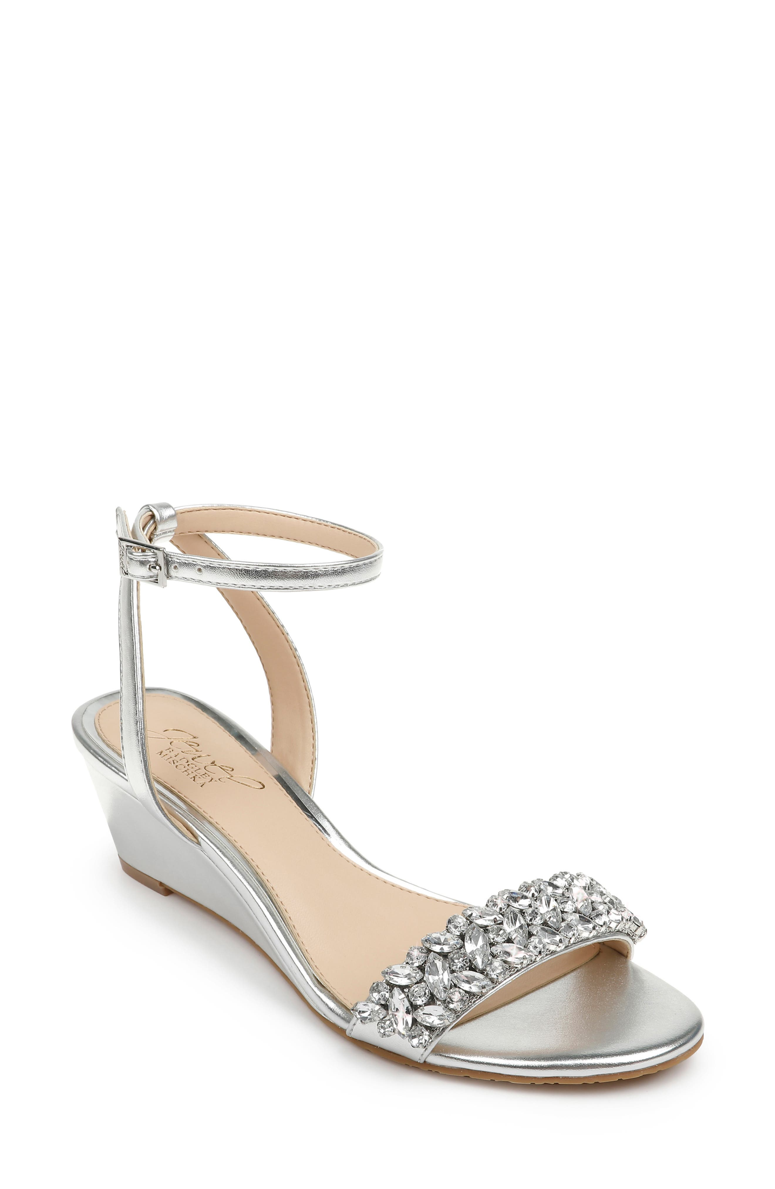 Sparkling crystals embellish the toe of a glamorous wedge sandal secured by a svelte strap at the ankle. Style Name: Jewel Badgley Mischka Bellevue Ankle Strap Wedge Sandal (Women). Style Number: 5959479. Available in stores.