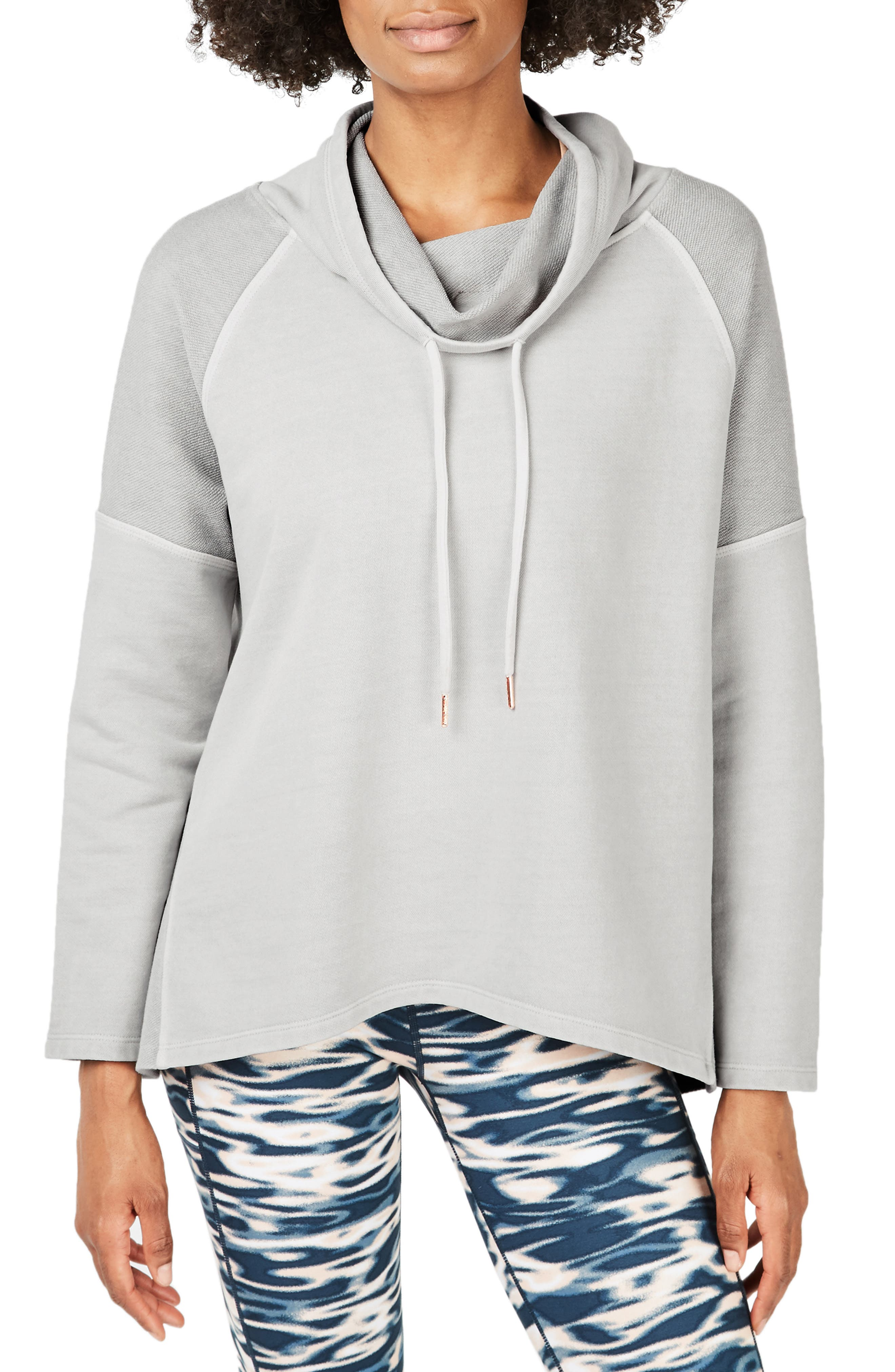 Keep your lounge look luxe in this drop-shoulder microterry hoodie updated with a flowy silhouette and a mix of smooth and reverse-loop textures. Style Name: Sweaty Betty Paradise Hooded Pullover. Style Number: 6042250. Available in stores.