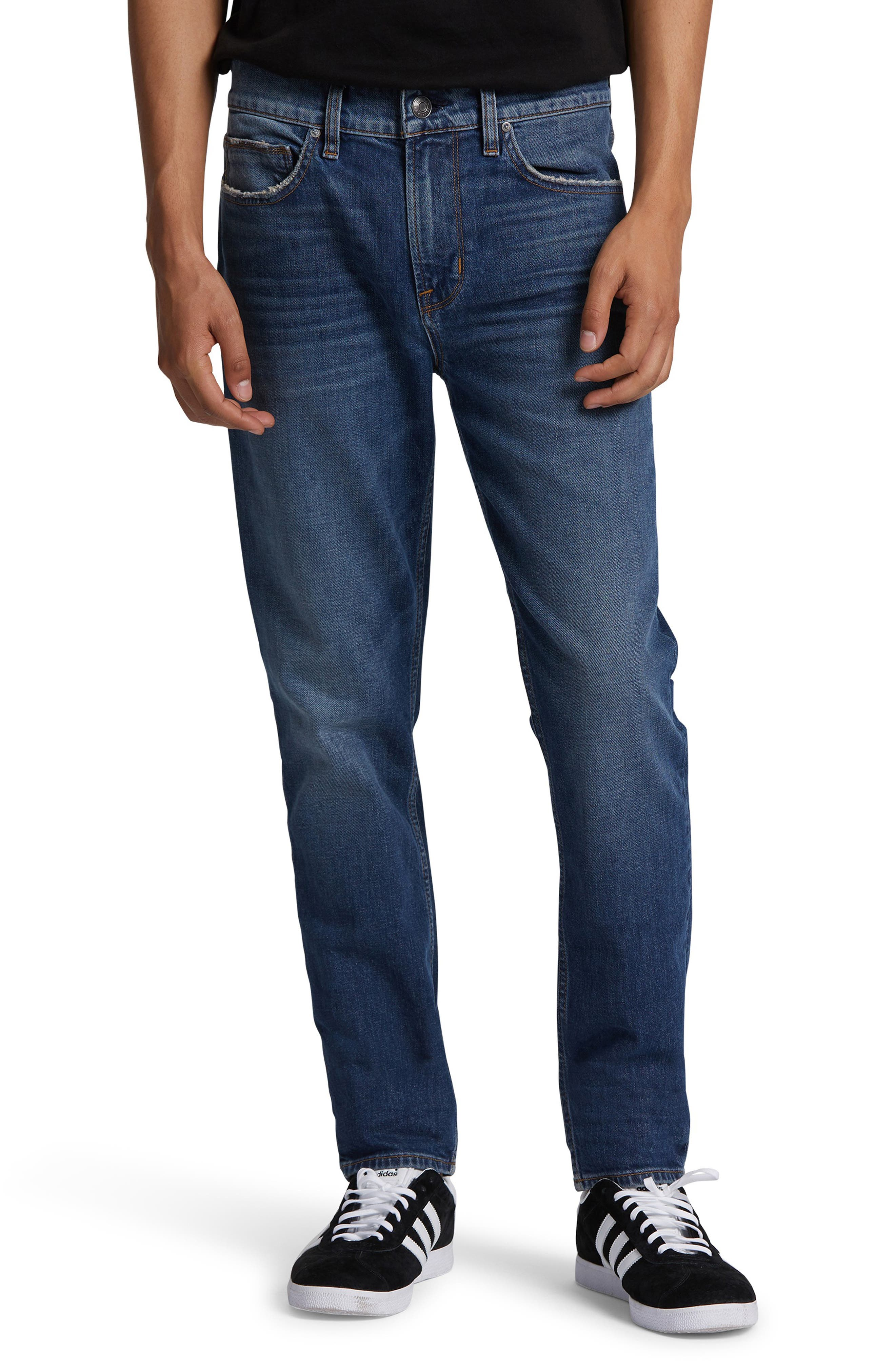 Heavy sanding and shredded edging thoroughly break in jeans cut from dark stretch denim with a mid-rise profile and skinny (but not too skinny) legs. Style Name: Hudson Jeans Axl Skinny Fit Jeans (Onside). Style Number: 6030640. Available in stores.