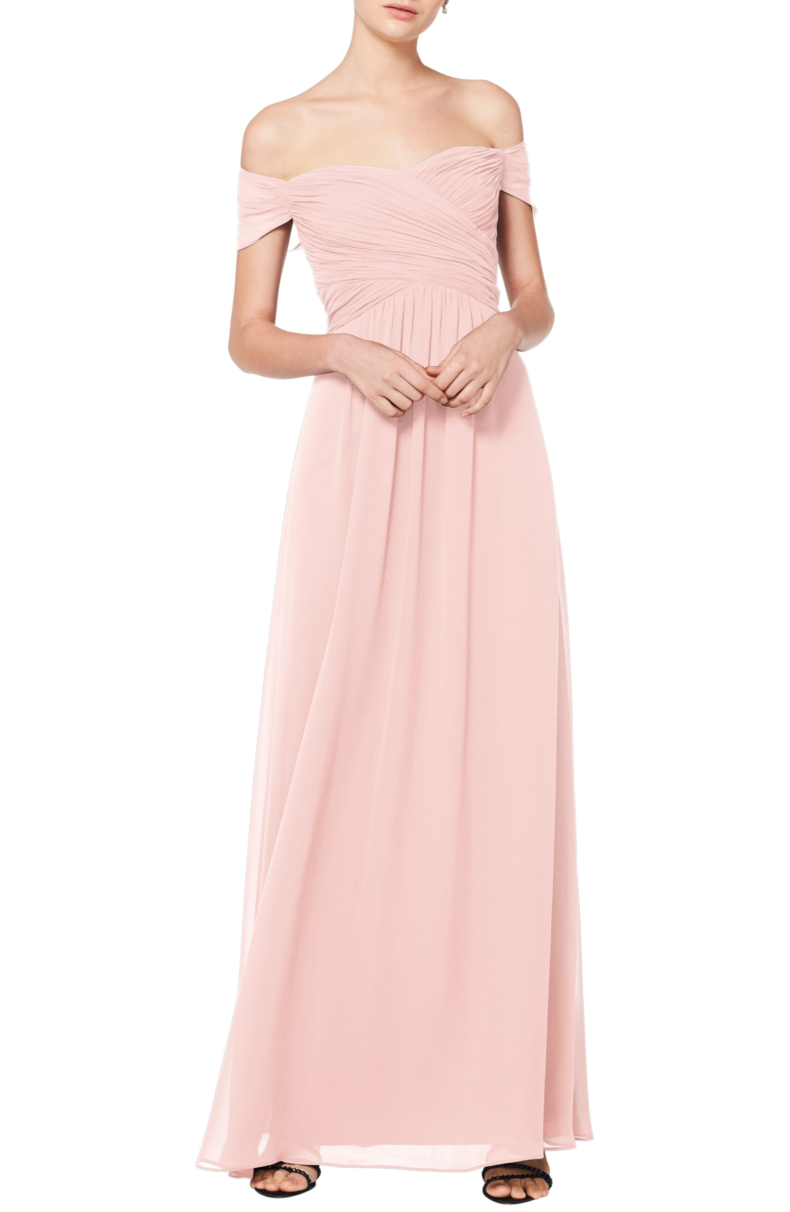 Simply romantic, with slender pleats and flowing chiffon, this shoulder-baring gown looks effortlessly elegant-because it is. The A-line silhouette makes the dress effortlessly flattering and perfect for bridesmaids or wearing to a formal event. Style Name:#levkoff Off The Shoulder Chiffon A-Line Gown. Style Number: 5774986 2. Available in stores.