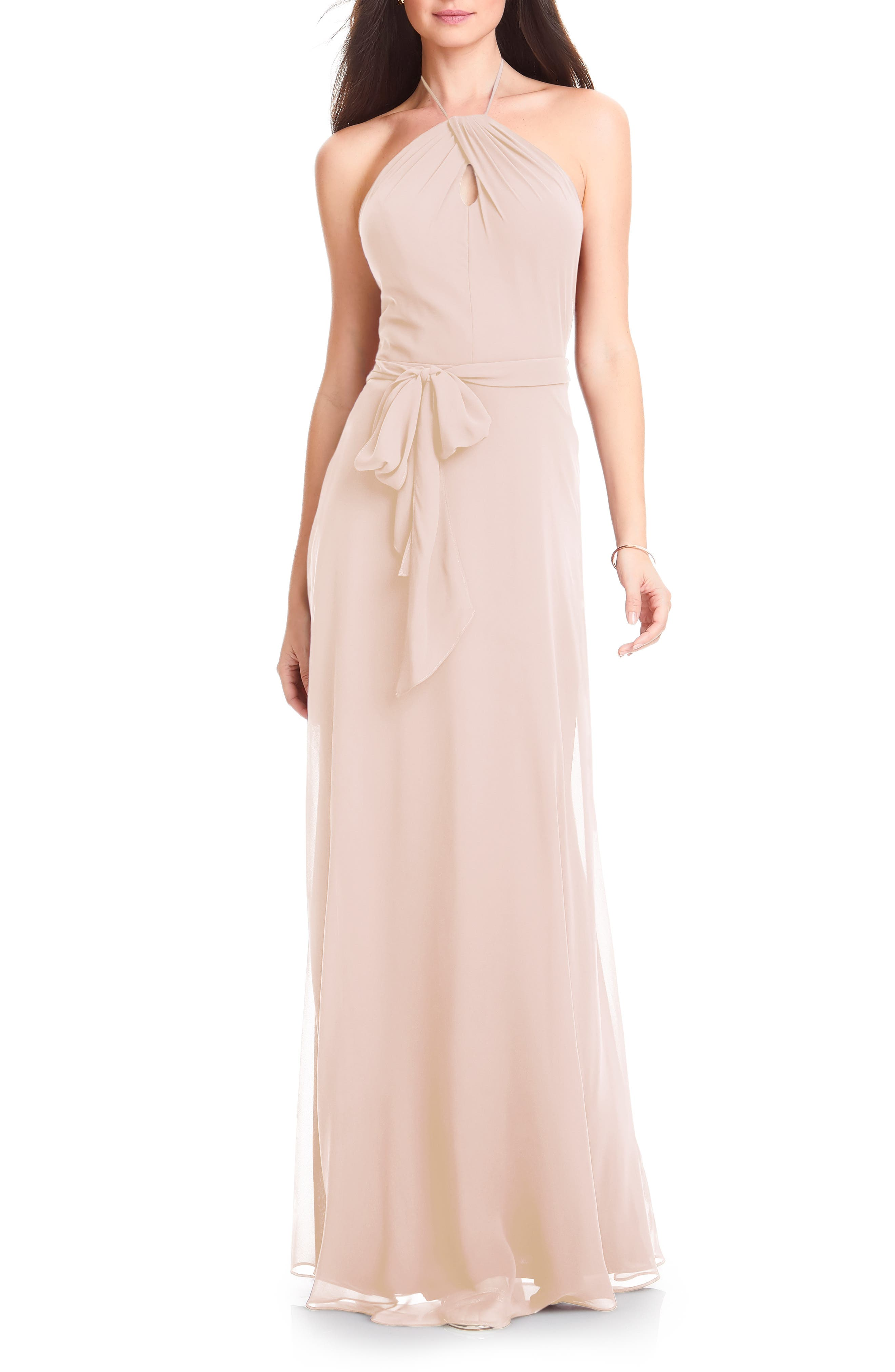 Simply romantic, with a twisted halter neck and flowing chiffon, this tie-waist gown looks effortlessly elegant-because it is. The A-line silhouette makes the dress effortlessly flattering and perfect for bridesmaids or wearing to a formal event. Style Name:#levkoff Halter Chiffon A-Line Gown. Style Number: 5697002. Available in stores.