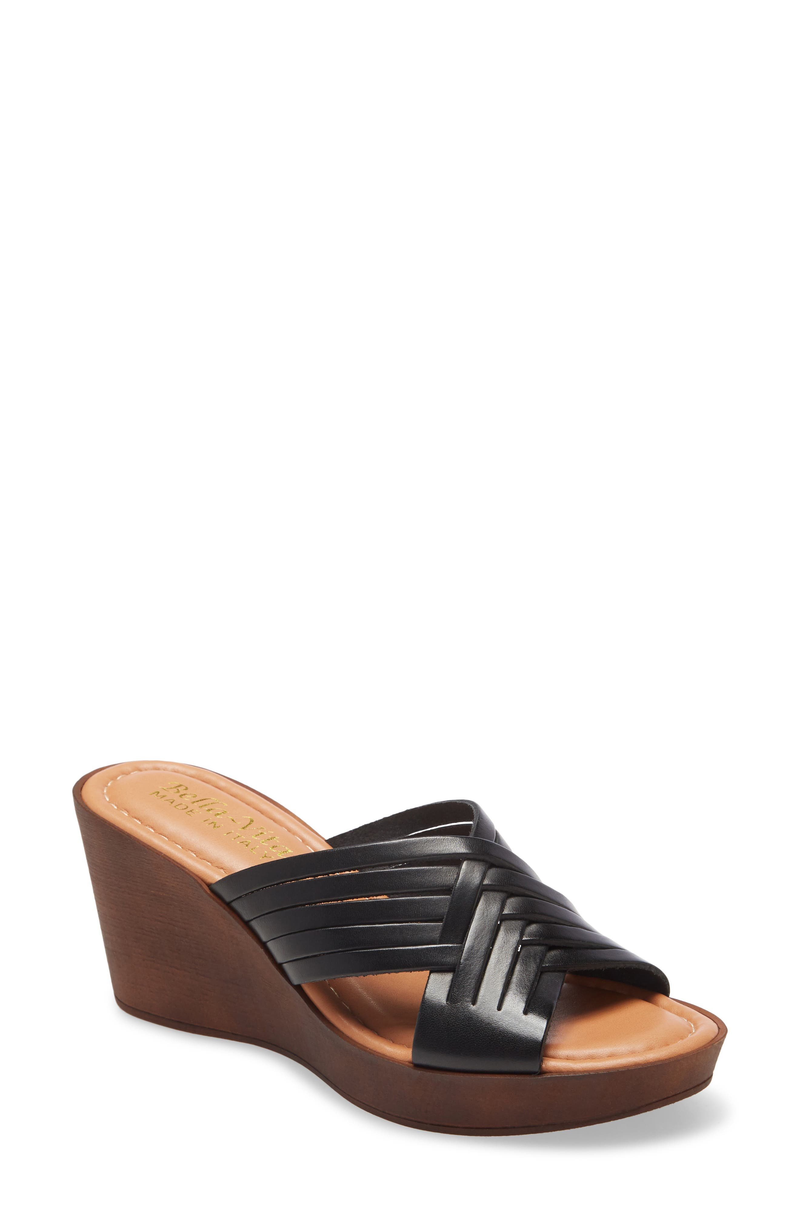 Italian leather straps cross at the vamp of a breezy slide sandal lofted by a woodgrain platform wedge. Style Name: Bella Vita Cat Wedge Slide Sandal (Women). Style Number: 5984398. Available in stores.