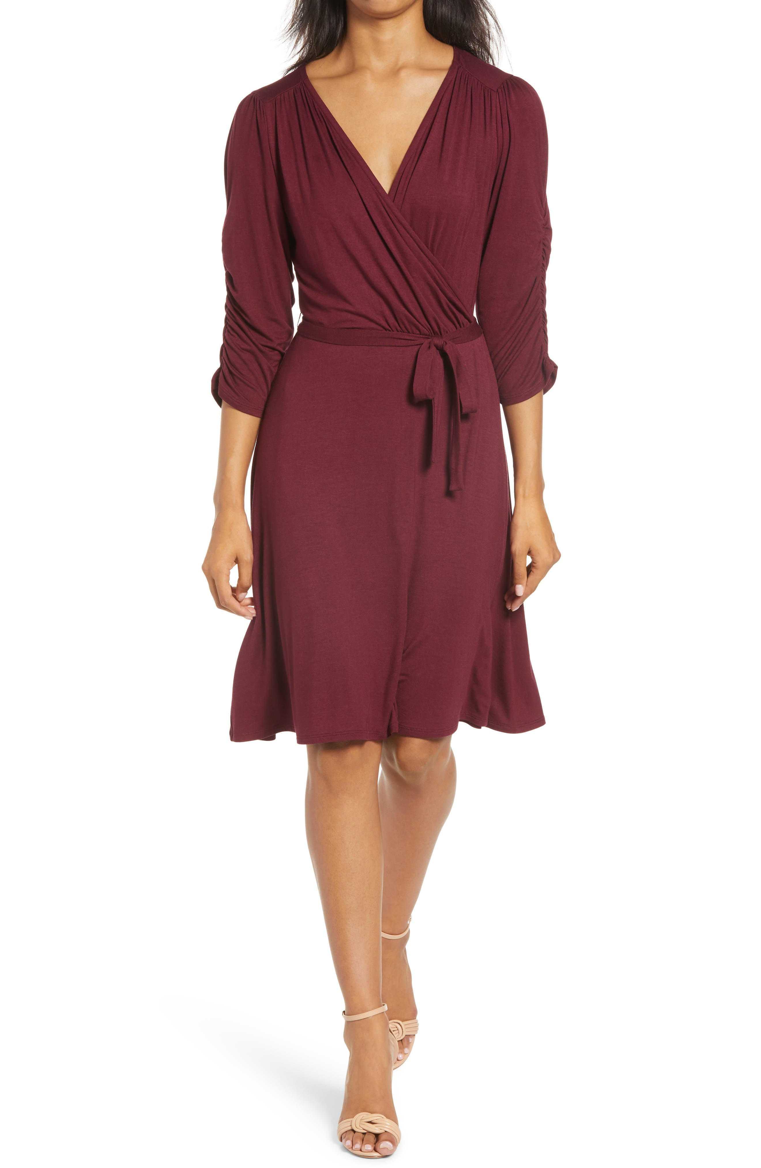 Rock your work-to-play look in this stretch-knit wrap styled with scrunched three-quarter sleeves in a variety of versatile hues. Style Name: Loveappella Tie Waist Wrap Dress. Style Number: 5975097. Available in stores.