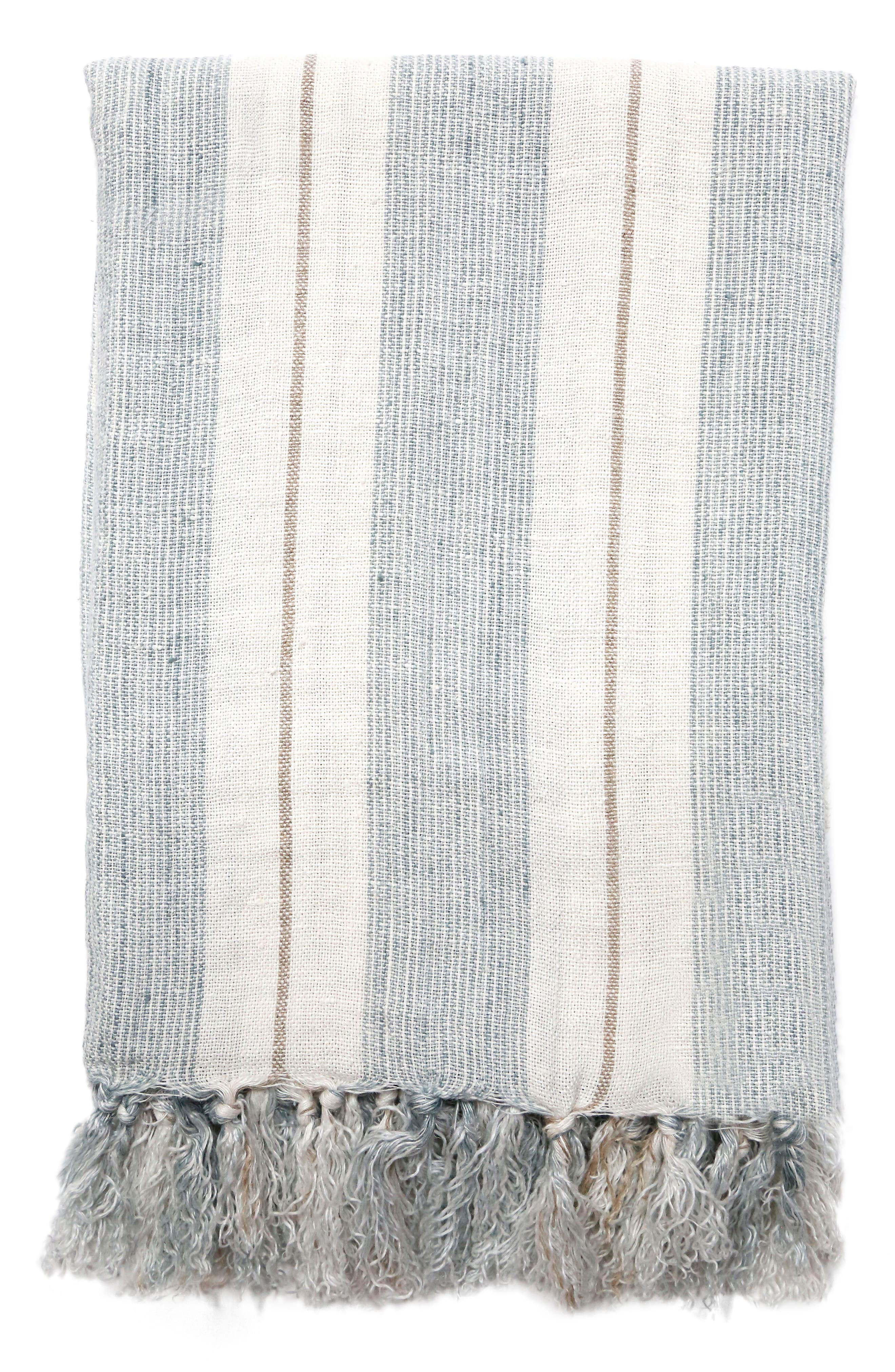 A beautifully striped throw blanket is hand loomed from soft, heavy linen and finished with thick, lush tassels. Style Name: Pom Pom At Home Laguna Throw Blanket. Style Number: 5437478. Available in stores.