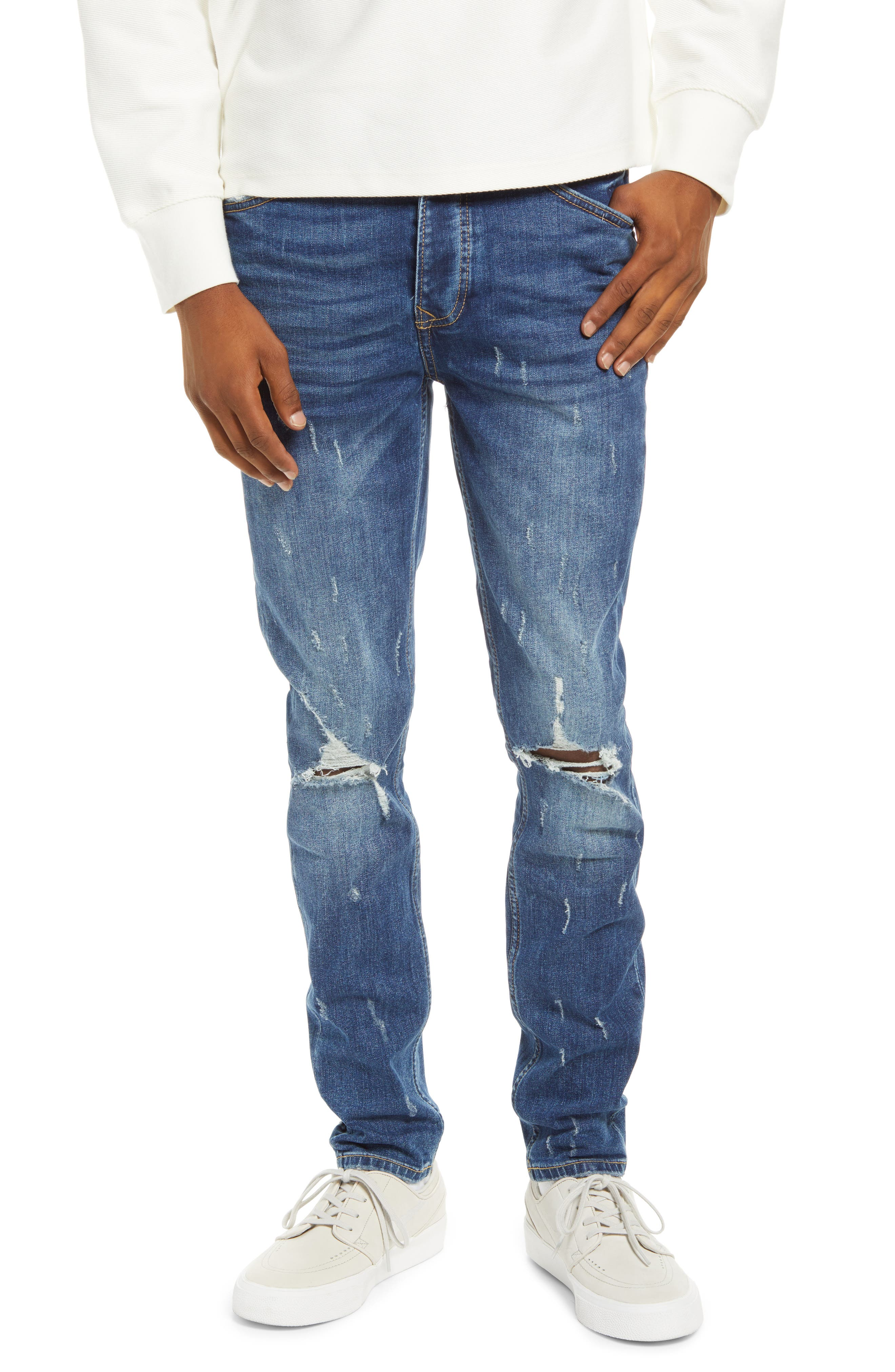 Edgy destruction brings chic appeal to these faded jeans that are soon to be an everyday favorite. Style Name: Topman Damage Ripped Blowout Jeans. Style Number: 6092334. Available in stores.
