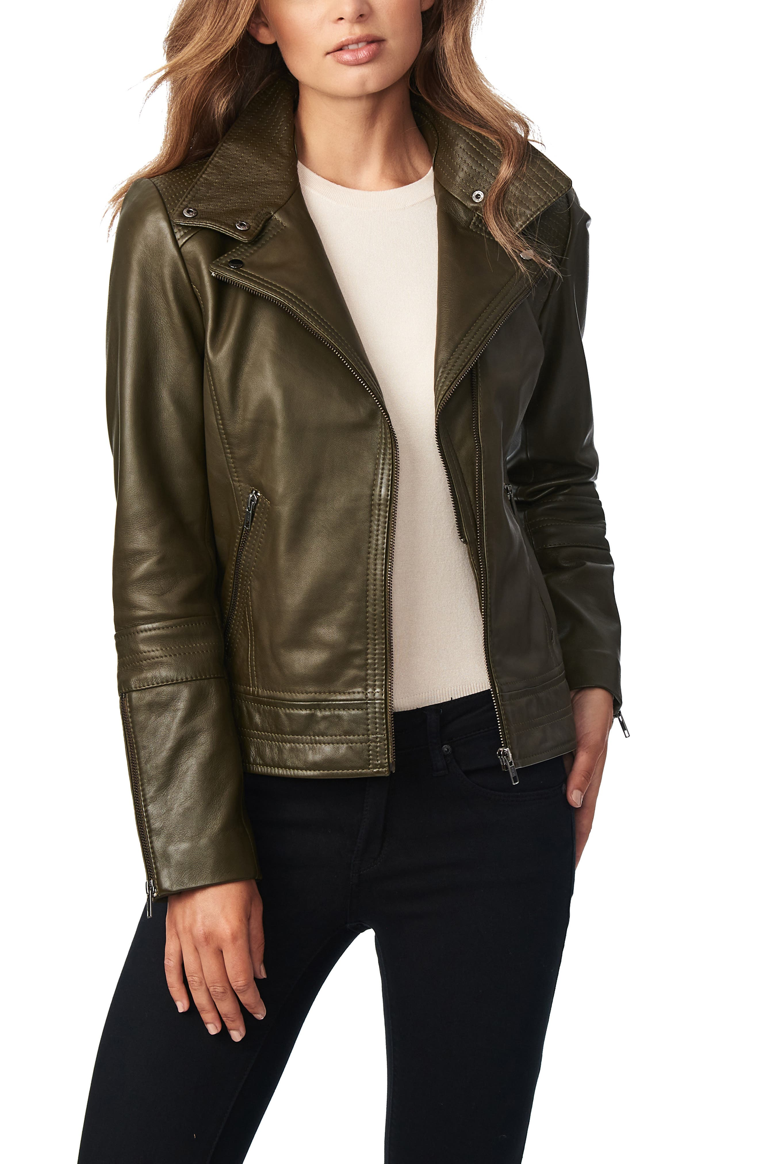 Trapunto stitching and vertical seams enhance the chic fitted silhouette of a modern moto jacket crafted from genuine leather. Style Name: Bernardo Leather Moto Jacket. Style Number: 5674939. Available in stores.