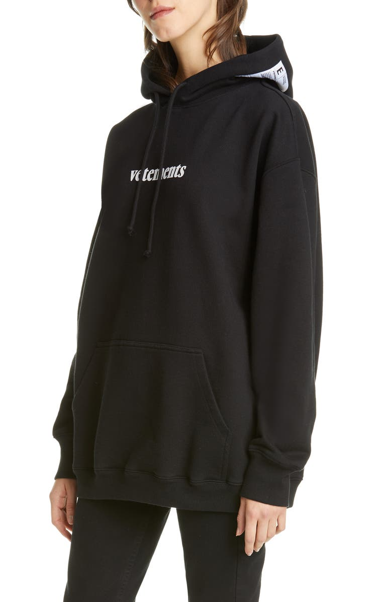 VETEMENTS Logo Shipping Label Graphic Hoodie, Main, color, BLACK