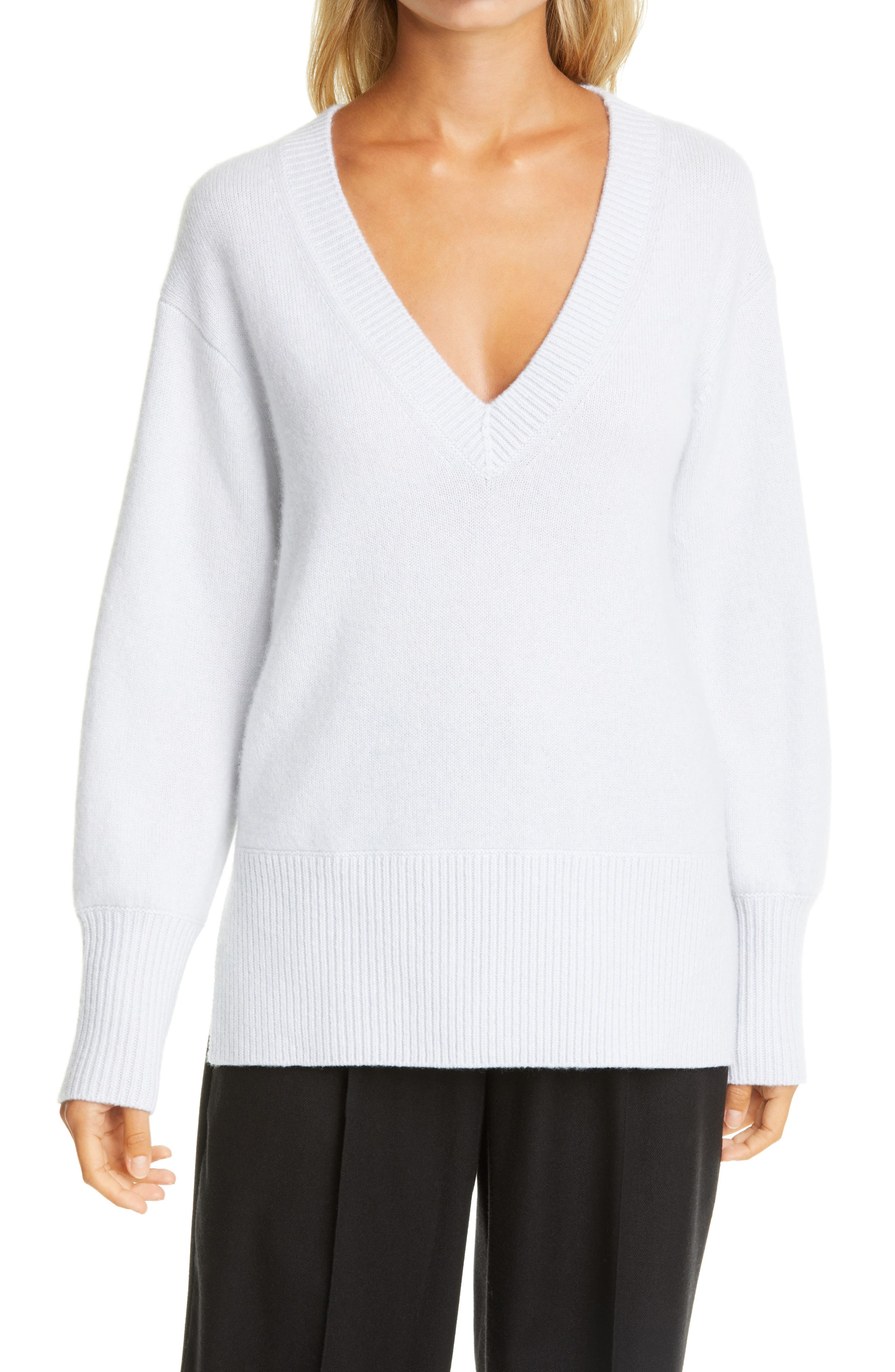 A ribbed V-neck, hem and cuffs trim an oversized cashmere sweater with a split hem for easy movement. Style Name: Vince Ribbed V-Neck Cashmere Tunic Sweater. Style Number: 6055826 1. Available in stores.