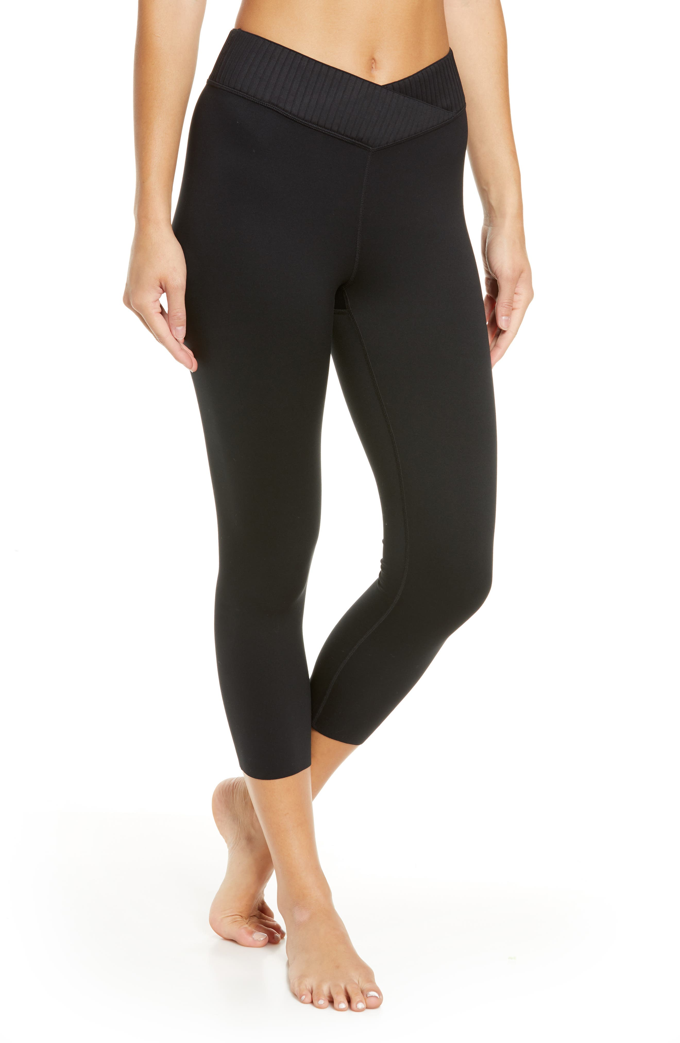A ribbed waistband dips into a crossover front for motion-free comfort in these sleek leggings with seamless crop hems and sustainable stretch fabric. Style Name: Zella Wrap High Waist Crop Leggings. Style Number: 6021483. Available in stores.