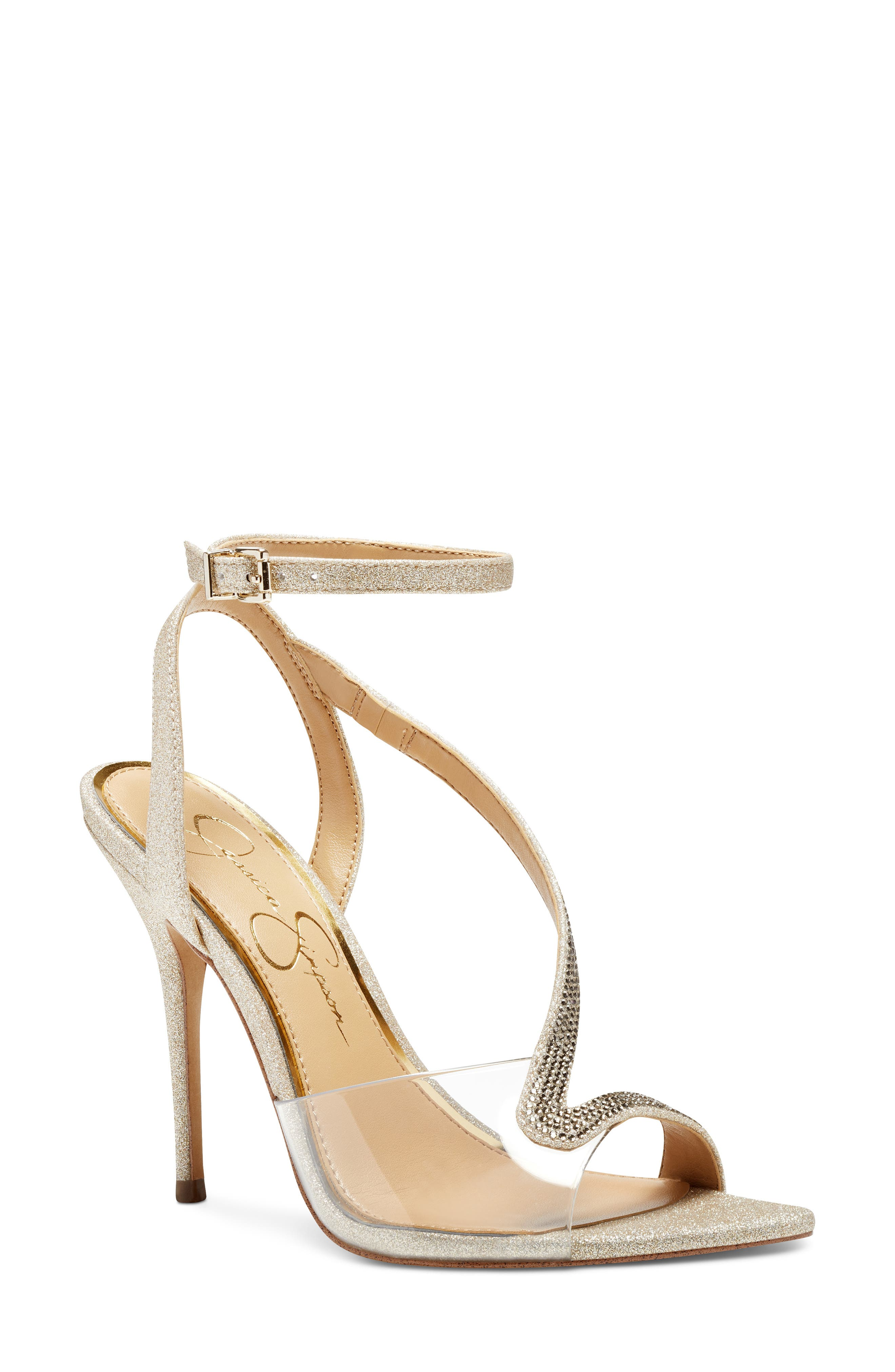 A transparent panel creates a dramatic illusion effect on a stiletto sandal topped with shimmery, asymmetrical straps. Style Name: Jessica Simpson Whitley Ankle Strap Sandal (Women). Style Number: 6101945. Available in stores.