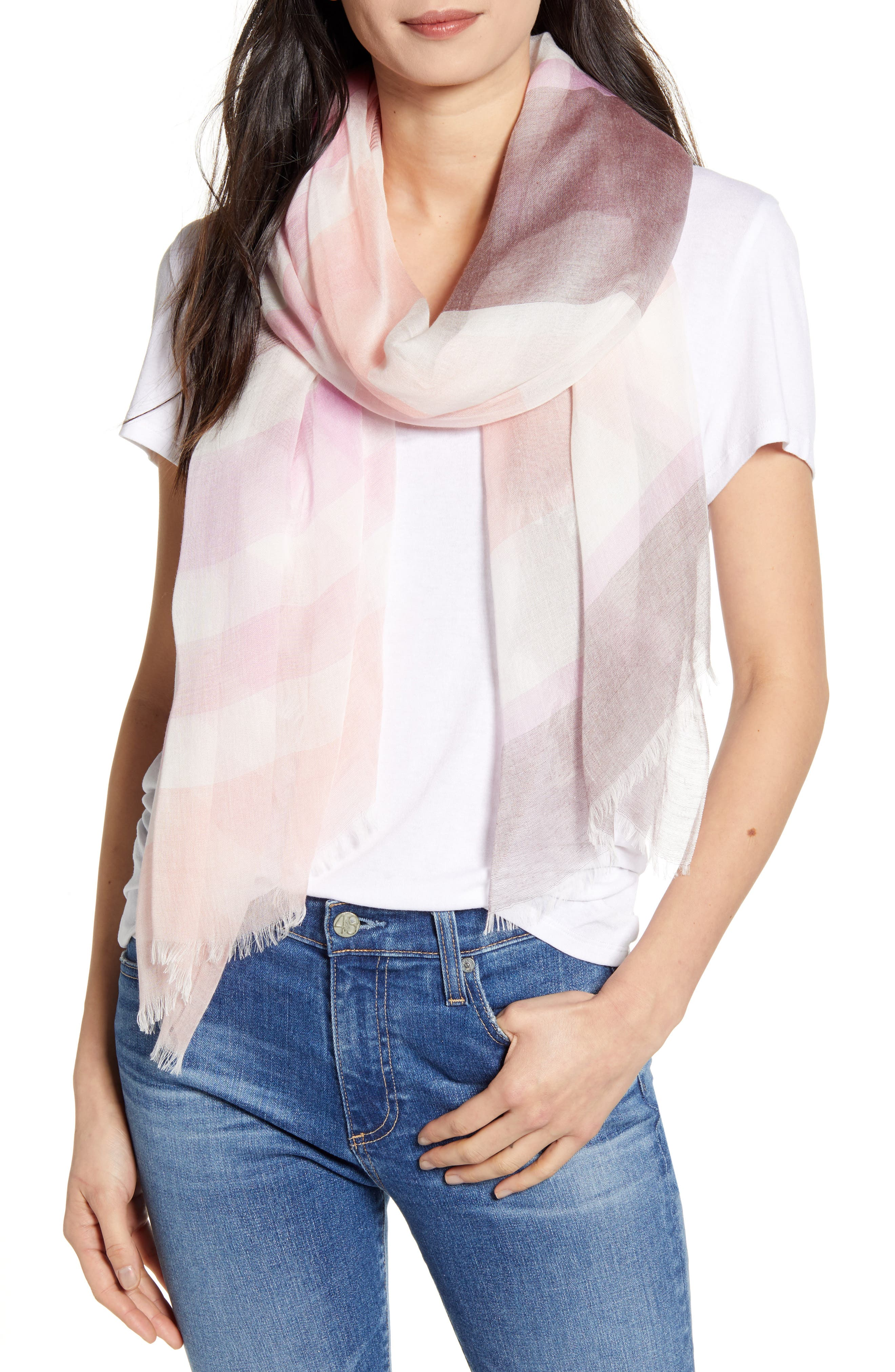 Softened with a whisper of silk, this gauzy, lightweight scarf is patterned in yarn-dyed stripes and tipped with soft eyelash fringe. Style Name: Nordstrom Yarn Dyed Stripe Wrap. Style Number: 5457089 11. Available in stores.