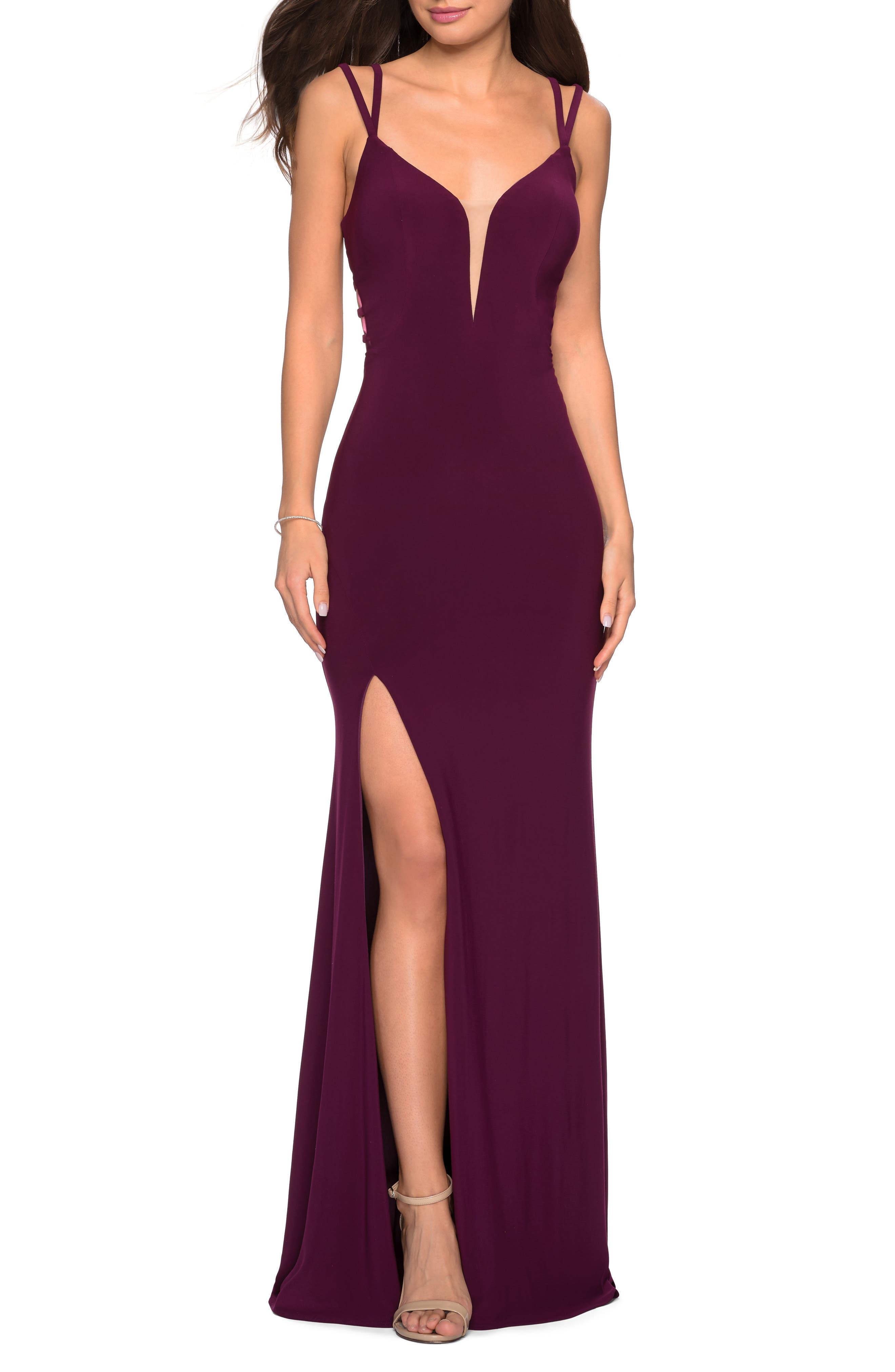 A rich jersey gown that shows your skin and sculpts your figure features a deeply plunging neckline, a high front slit and a web of intrigue at the dipped back. Style Name: La Femme Strappy Back Jersey Column Gown. Style Number: 5780199 2. Available in stores.